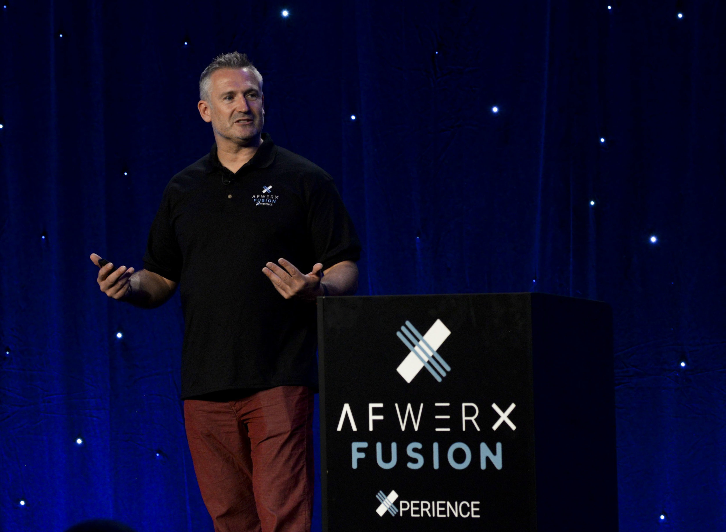 Mark Rowland, Innovation Actualizer at AFWERX Vegas, speaks to a crowd of attendees at the AFWERX Fusion Xperience event in June 2018. AFWERX Vegas provides a hub for innovators dedicated to making creative fixes for the Air Force's toughest challenges. PHOTO: U.S. Air Force Airman Bailee A. Darbasie