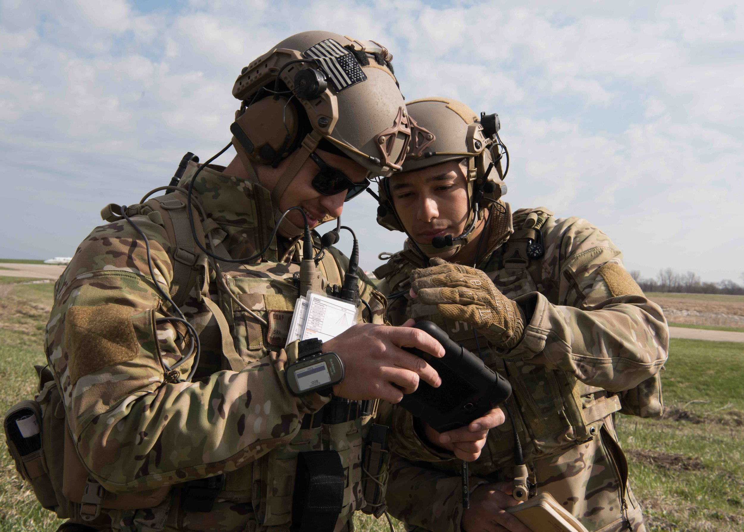 Two U.S. Air Force Joint Tactical Air Controllers (JTAC) with the 7th Air Support Operations Squadron from Fort Bliss, Texas, call-in simulated air strikes during the Reaper Flag exercise on April 2, 2019, in Sedalia, Mo. Using tactical radios and ruggedized tablets, the Airmen are trained and equipped to deploy with land forces, in order to coordinate airspace and missions including Close Air Support (CAS). Photo by Airman Parker J. McCauley.