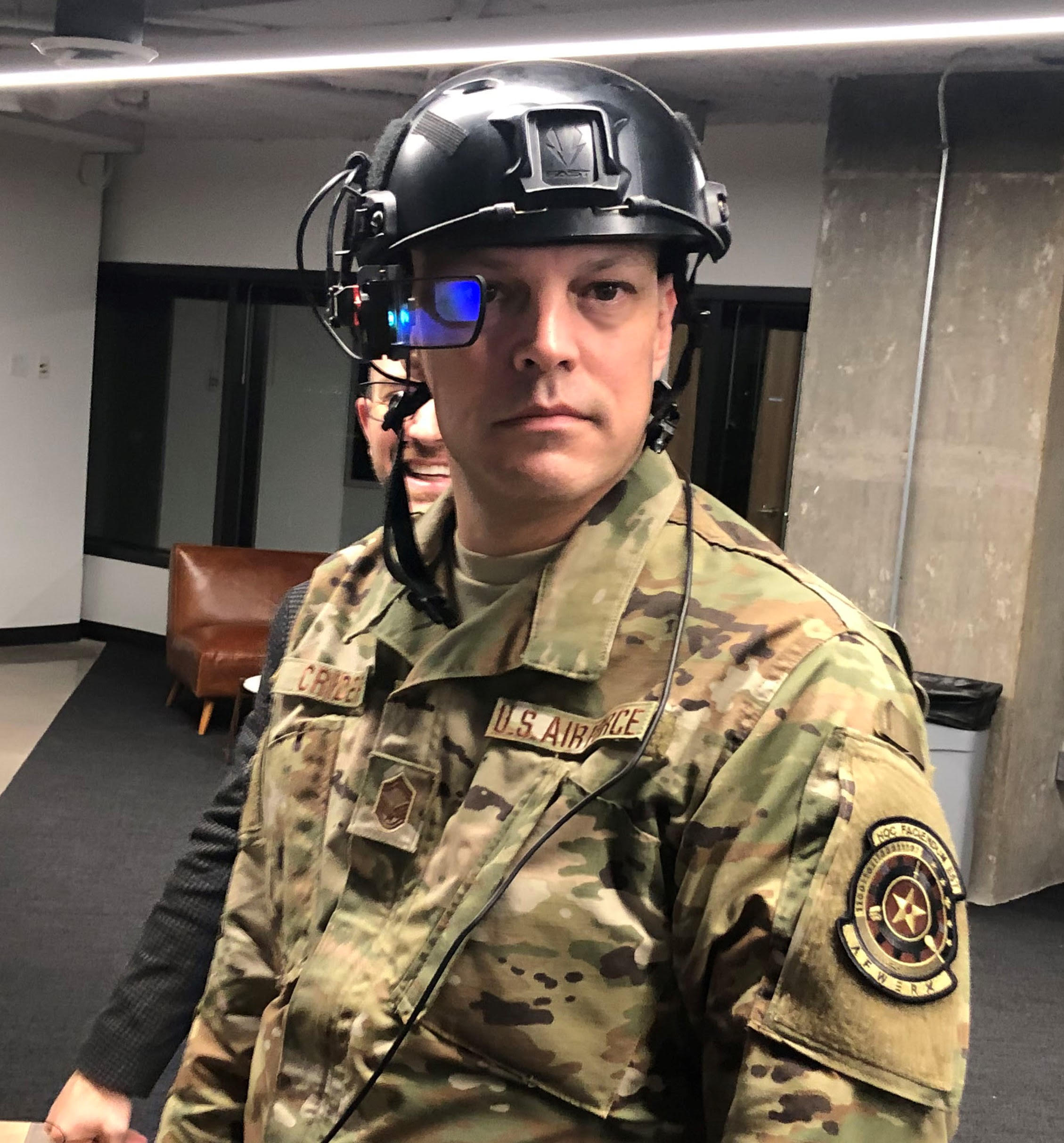 U.S. Air Force Senior Master Sgt. Powell Crider demonstrates an Augmented Reality (AR) headset. Photo courtesy of AFWERX Vegas