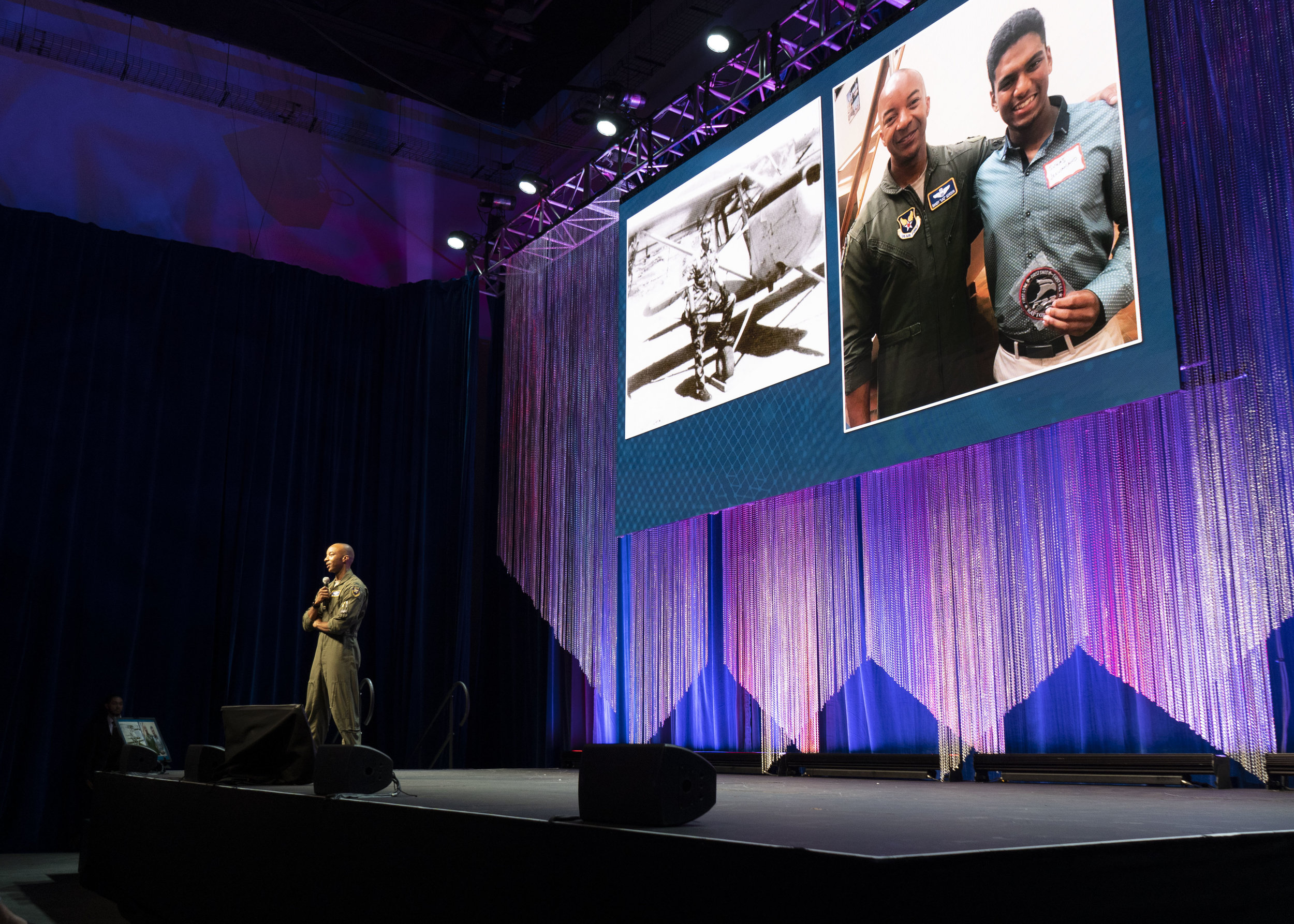 "U.S. Air Force Col. Randy ""Laz"" Gordon, test and evaluation lead for AFWERX Vegas, speaks to a sold-out audience of 1,200 registered innovators from the military, business, academia, investment and more at the 2019 AFWERX Fusion Xperience held July 23-24 at the Enclave event center In Las Vegas The annual event includes speakers, panels, and product showcases focused on solving U.S. Air Force priorities with existing commercial products and concepts."