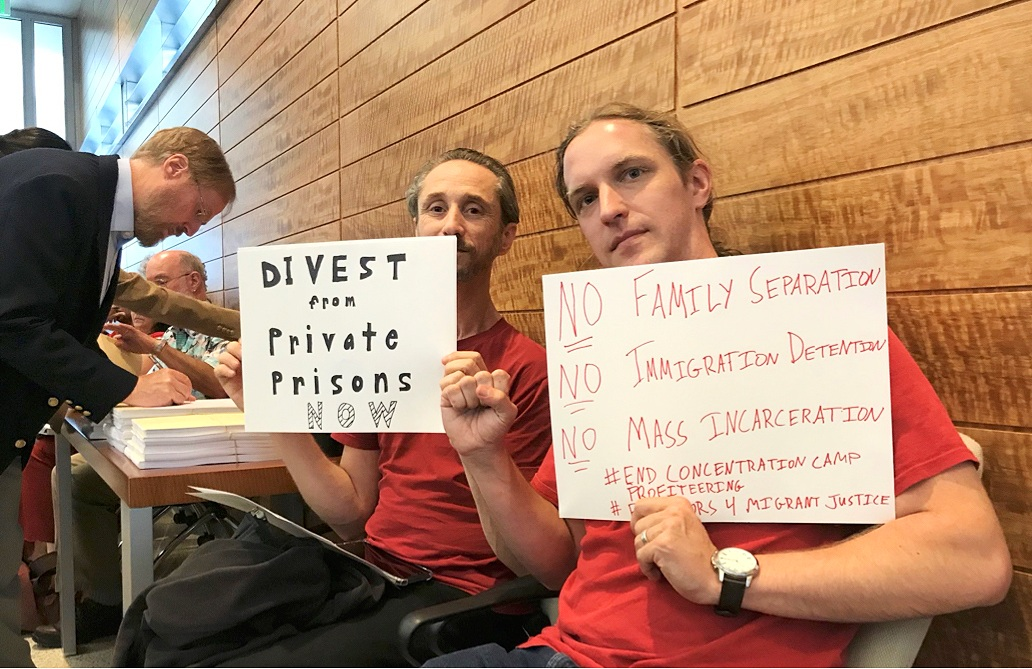 Berkeley High School Educators hold up signs calling for CalSTRS to divest from for-profit prisons at the July 2018 board meetings.
