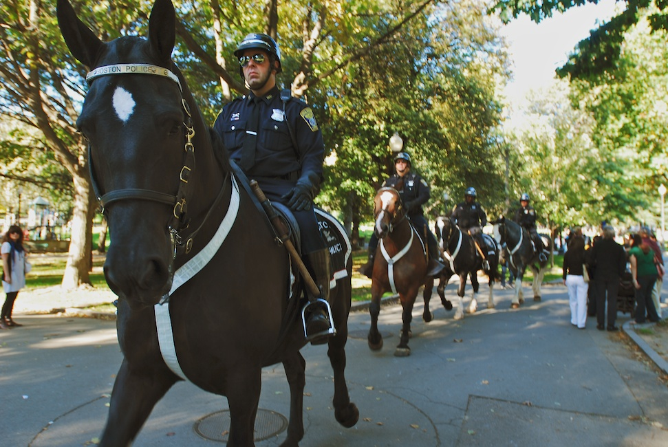 Boston, Mass - Oct. 11, 2008: Police officers mounted on horseback make their way across the Boston Common in anticipation of the anti-war march taking place in downtown Boston. They waited at the entrance of the Common where the march was scheduled to end, though no major violence or arrests were reported. Photo by Andrew Bisdale.