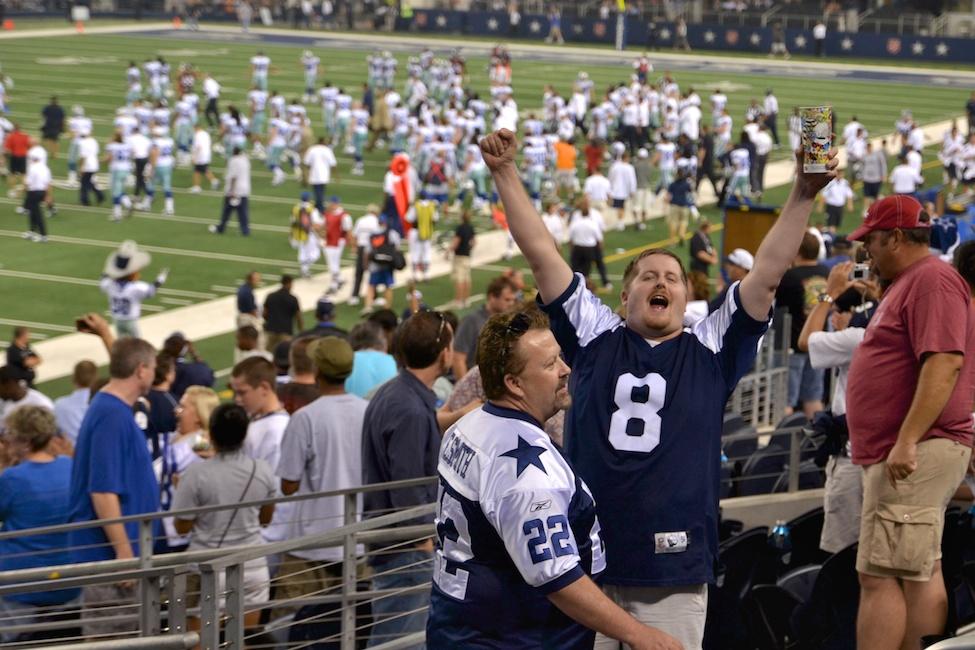 Arlington, Texas - Aug. 11, 2011: Fans celebrate as the Dallas Cowboys win the preseason opener against the Denver Broncos at Cowboys Stadium.