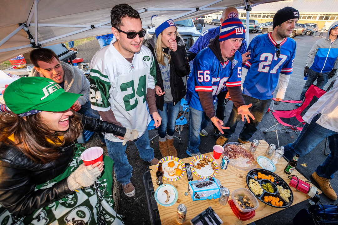 East Rutherford, NJ - Dec. 6, 2015: Jets and Giants fans tailgate in the parking lot of MetLife Stadium for  a rare regular season matchup between the two teams.