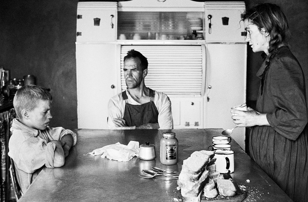 A plot-holder, his wife and their eldest son at lunch, Wheatlands, Randfontein , Sept 1962
