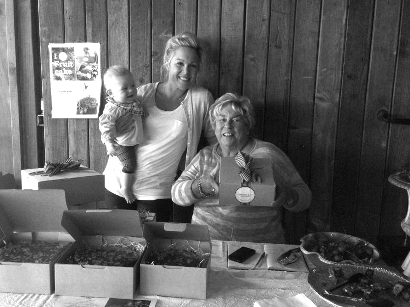Sherry (with baby Georgie) and Aud, selling fruitcakes at the Matakana Country Park Market in 2013.