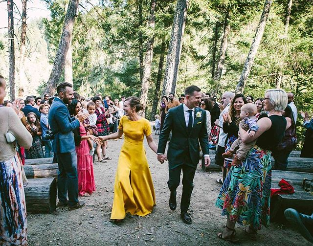 "Beth and Graham got married at a summer camp deep in the woods, with a casual, heartfelt, laughter-filled weekend that was perfectly reflective of them. After the ceremony, their recessional back down the aisle was a tunnel of love and high-fives. Swipe through for one of the most joyful and unguarded ""WE JUST GOT MARRIED"" looks ever ever ever. 💛💛💛"