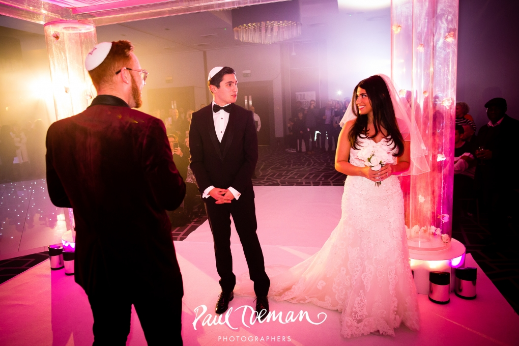 - Once guests entered the ballroom, they were greeted with an authentic chuppah set up complete with a bride and groom (already married at their very own TOTEM wedding). The ceremony did not disappoint and was the perfect showcase for how TOTEM can bring a room full of people to silence to witness your very special moment.