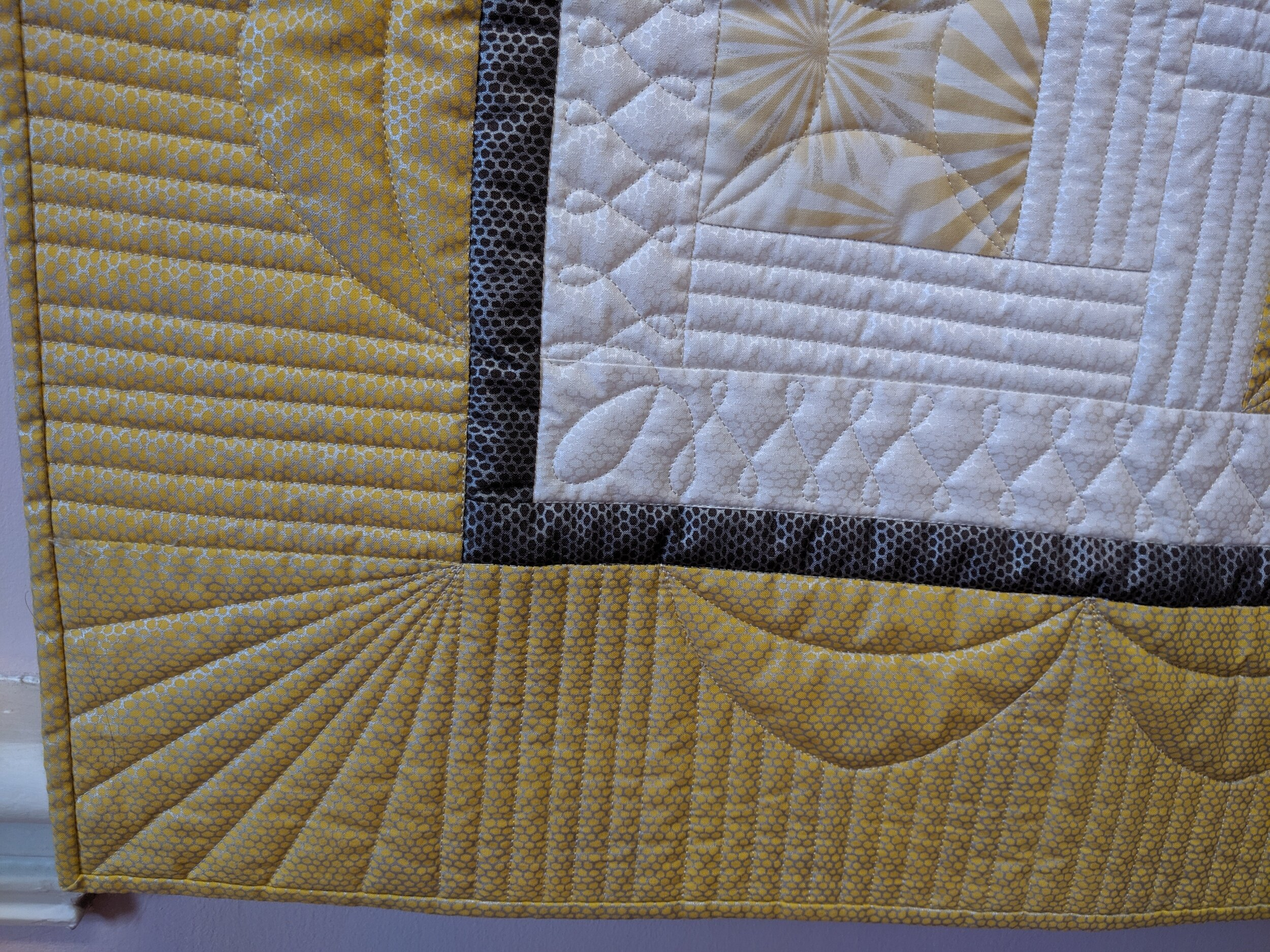 Close-up of custom quilting.