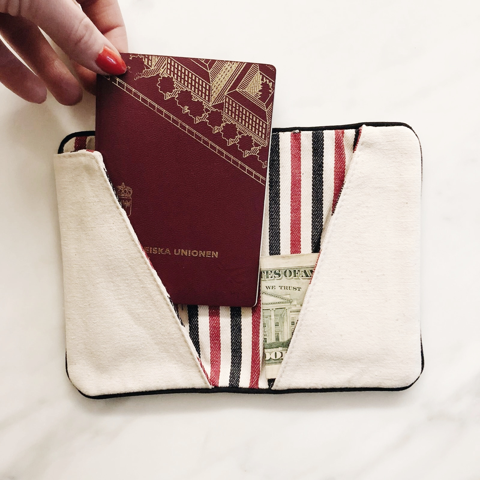 Don't loose it - Airports can be a stressful place and it's so easy to misplace you passport and boarding card in the hustle bustle. Keep your things collected in one place with our passport holder. Extra tips is to monogram your name on it so you can tell straight away whom it belongs to.Price $20.00