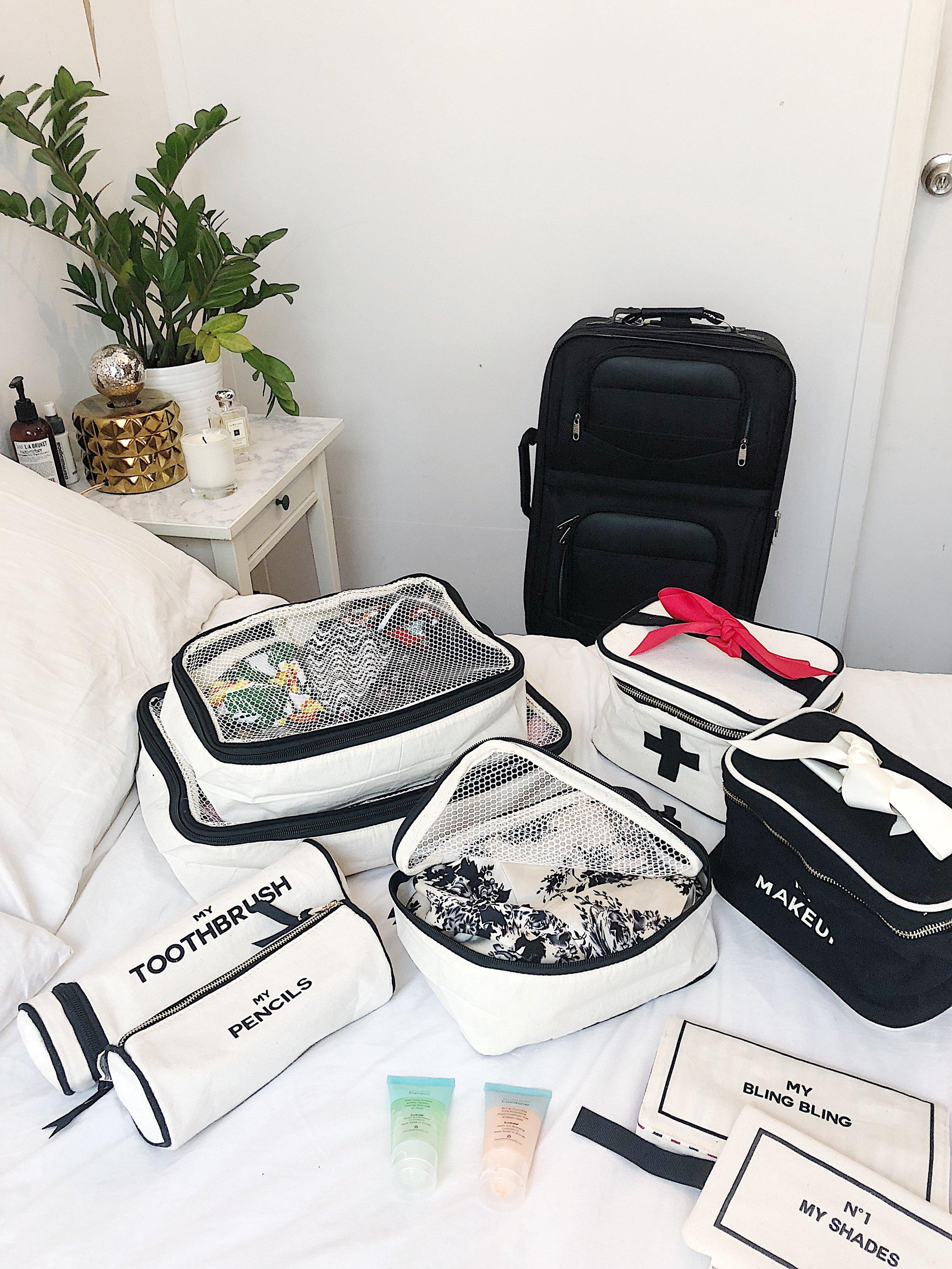 my toothbrush , black beauty box, blank packing cubes, my pencils, my bling bling, my shades, medical box cross mood Bag-all.jpeg