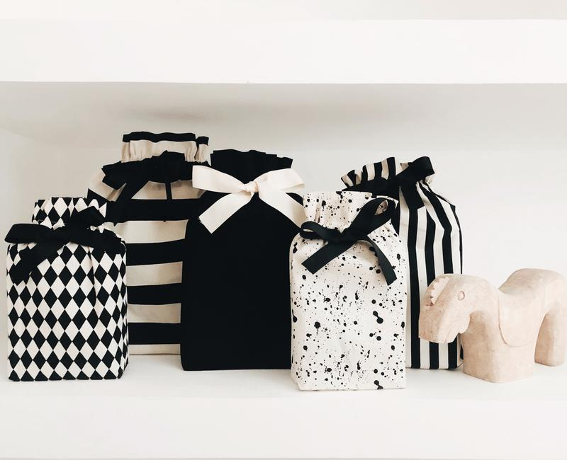 new gift bags - We have created a brand new gift bag collection! Can be used any time of year! The colors are natural and black and comes in Black, Stripe, Diamond and Splatter. All the bags have a bottom so they can stand!