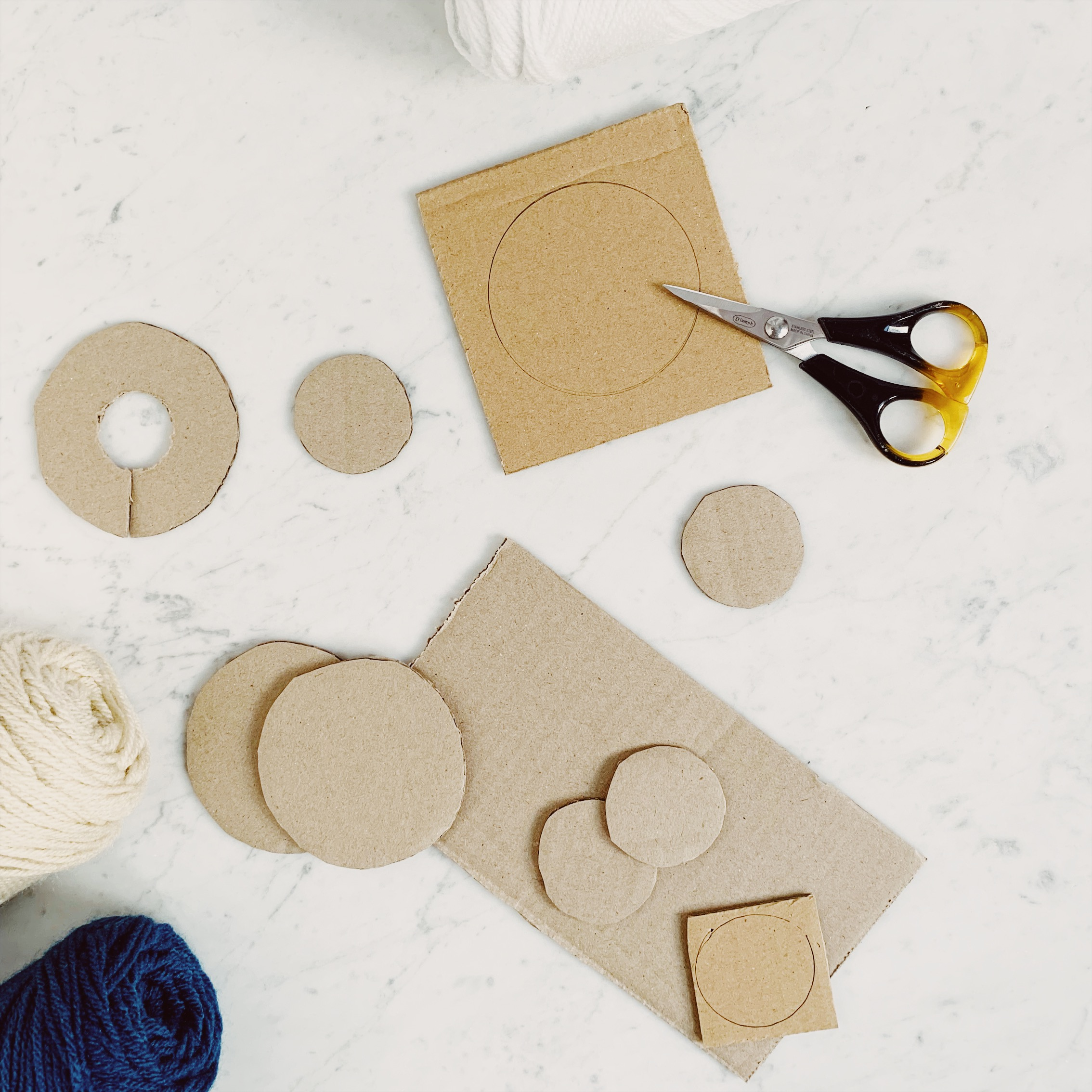1. Make a cardboard Pom Pom template -