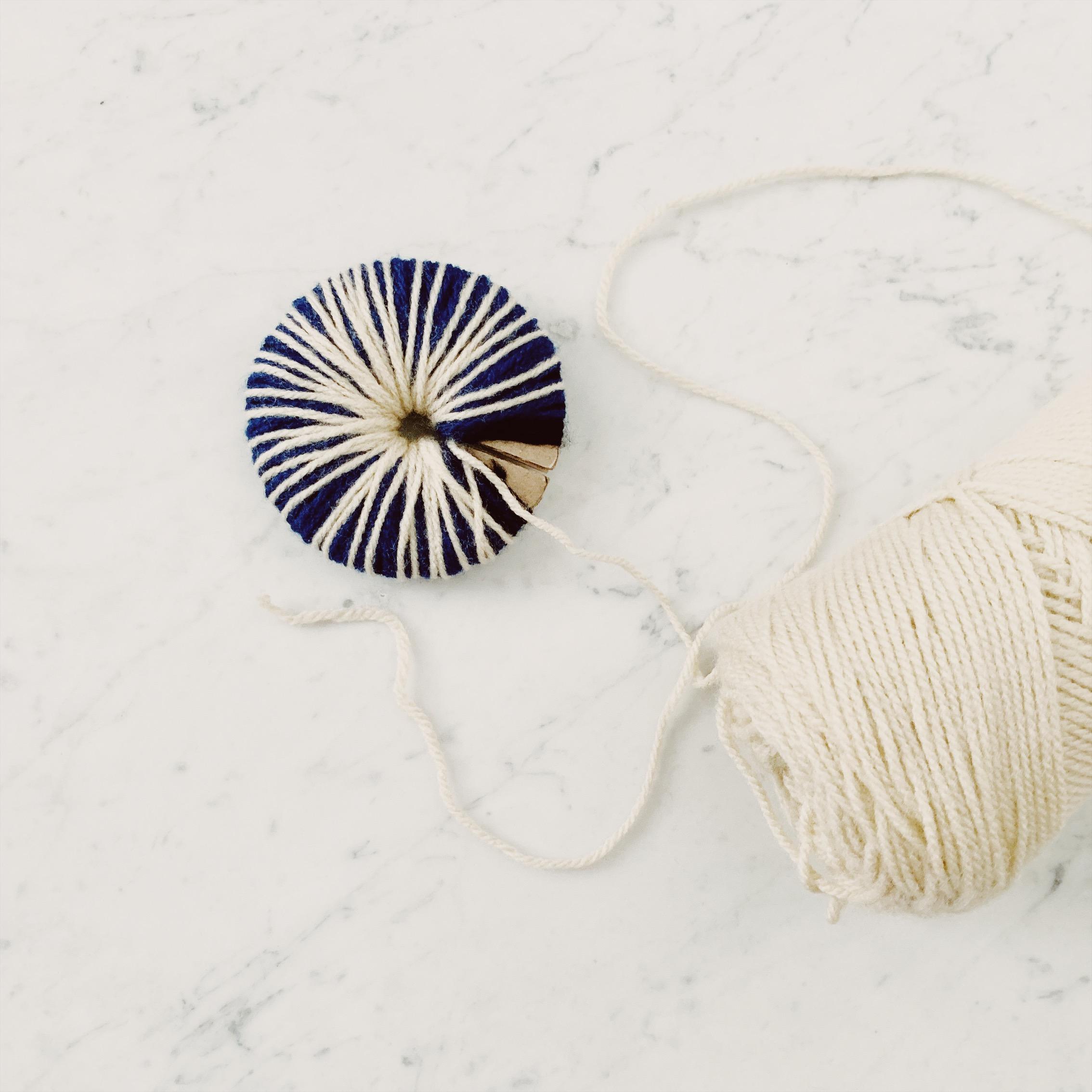 2. Wrap yarn around the cardboard ring -