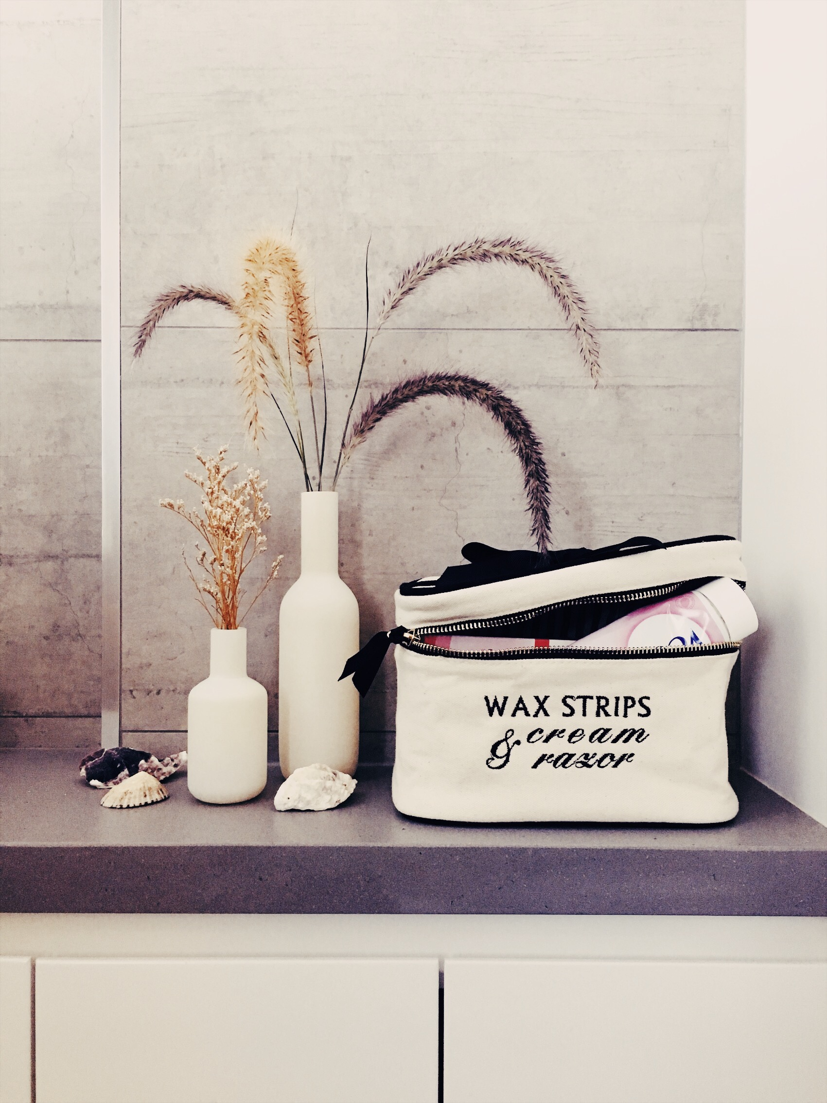 store your products in style - Fellow designers, we've reached the end of our list. However, this tip may be one of the most important ones yet: the importance of storing your items in style. That half-empty toothpaste tube laying around isn't gonna do much for your bathroom. Invest in some stylish, functional and sustainable storage items. Everything from a cute box to a basket or an organizing bag will do wonders for your space. And the best part, it doesn't have to cost you much at all.See picture for a customized version of our Blank Large Beauty Box, and don't forget, this box can store whatever you need it to store. It's up to you and your imagination.Below, we have our Lotions & Potions Case next to our My Brushes Case. These cases have a laminated inner lining, which prevents the fabric from getting ruined from leaking lotions and creams. When they're not functioning as stylish storage on your shelves, they're both excellent travel partners.