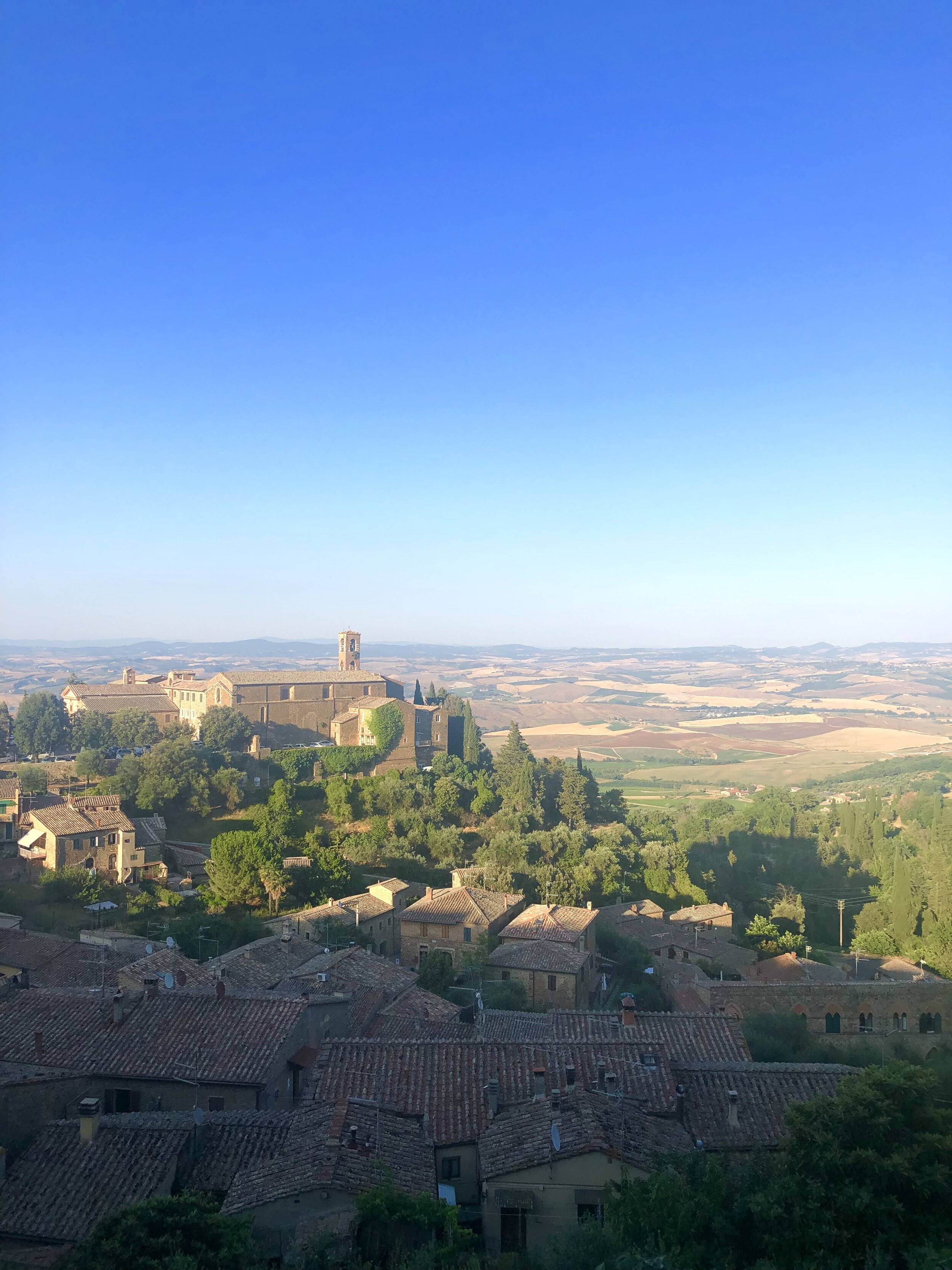 """- Montalcino - This small village is the home of the Brunello wine, which is considered one of the best wines there is. So make some time to visit Castello Banfi. You will be able to visit the winery as well as enjoying a set 5 course meal while watching the sunset. Obviously, the meal is paired with Brunello wines.San Gimignano - This UNESCO site is called the """"Manhattan of the Middle Ages"""" for its many towers. Don't forget to try the gelato at Gelateria Dondoli.Montepulciano - Montepulciano is larger version of Montalcino, packed with great resturants, wine bars and art galleries. Its known for Vino di Nobile di Montepulciano and the local thick pasta, called Pici pasta.Siena - Start the day by visiting Piazza del Campo, the big square in the middle of the city. Siena is larger than most of the other villages in Tuscany. Which means there is a lot more options for shopping here. So if you are looking for something local to bring home, this is where you can find it.Florence - One of Italy's largest city, so you will not get that small Tuscan Village feel here. Although there is lots to do and see. If you like sculptures and architecture you should not miss Florence! On the way to or from Florence, you can also stop to do one of the many cooking courses surrounding the city. On these courses you will learn how to make your own pasta, and make a true Italian meal."""
