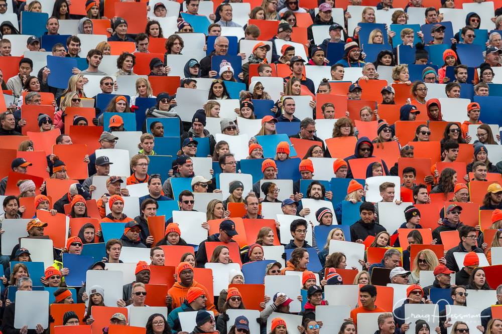 Photo taken by Craig Pessman of Block I's card stunt during halftime of a football game.
