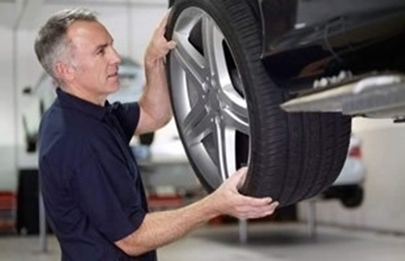 Tire repair at Bear Frame & Alignment Services, Inc. Kearney, NE