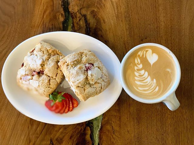 Fresh strawberry scones from @whisk_and_rye and a perfectly poured latte.  Stop in for a treat!