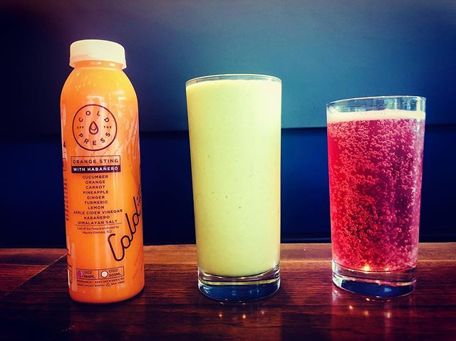 Cold drinks for hot days!  Featured left to right: @coldoffthepress Orange Sting, @coldoffthepress Green Smoothie, and @home.bucha Triple Berry Kombucha.  Stop in for an afternoon pick-me-up! 🌷
