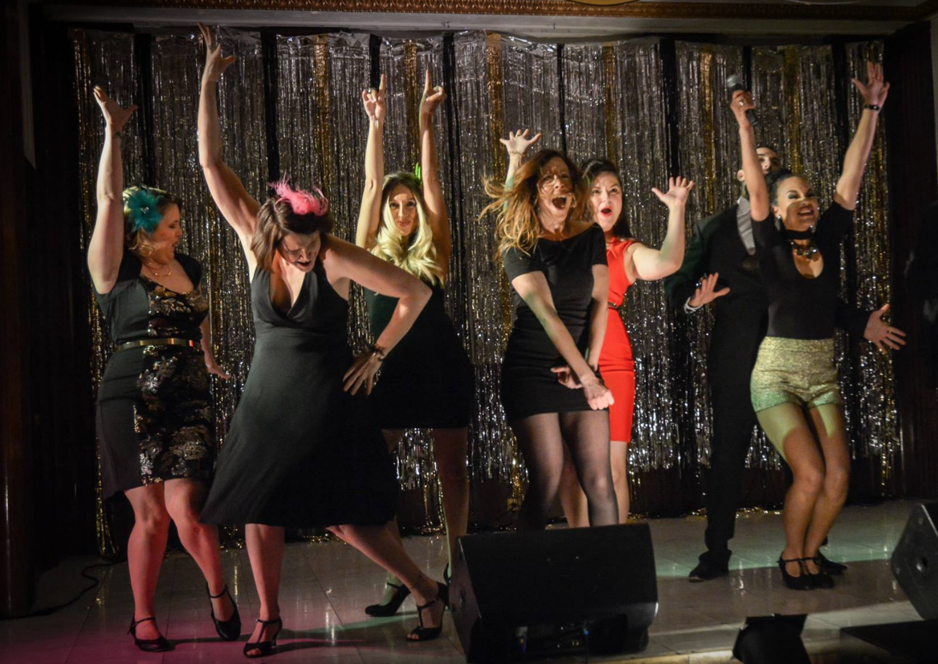 Great action shot of the opening number for Spring Forward Benefit 2017: Ravenswood Goes Retro. Director: Tamara Drew, Choreographer: Heather Kroski, Photo by Manuel Ortiz