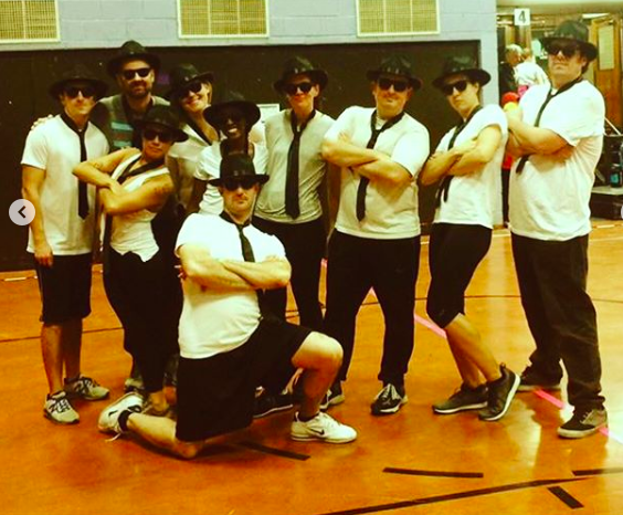 "First grade parents competing as the ""Black and Blues Brothers"""