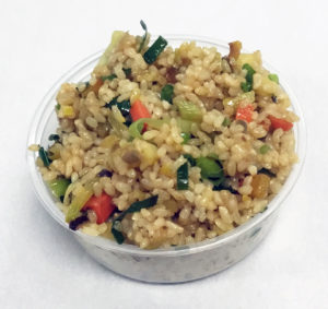 Stir fried brown rice with sweet potato, carrot, broccoli stems and leeks.