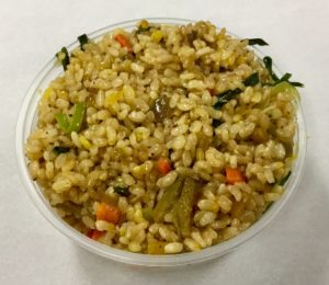 Stir fried brown rice with onion, carrot, cabbage, leek, scallions and celery seeds.