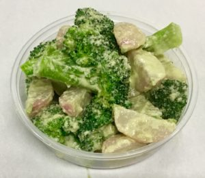 Boiled salad of broccoli and red radish with a sesame seed dressing.