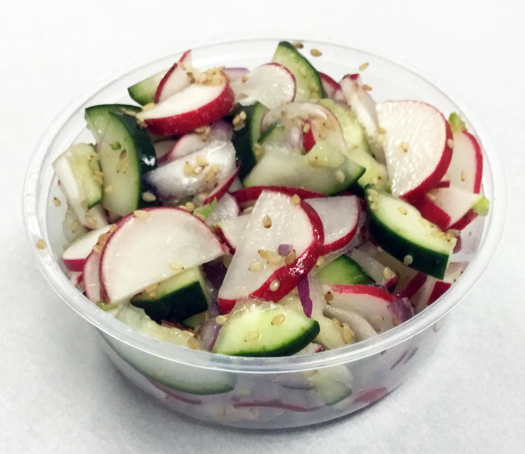 Red radish, cucumber and toasted sesame seed pressed salad.