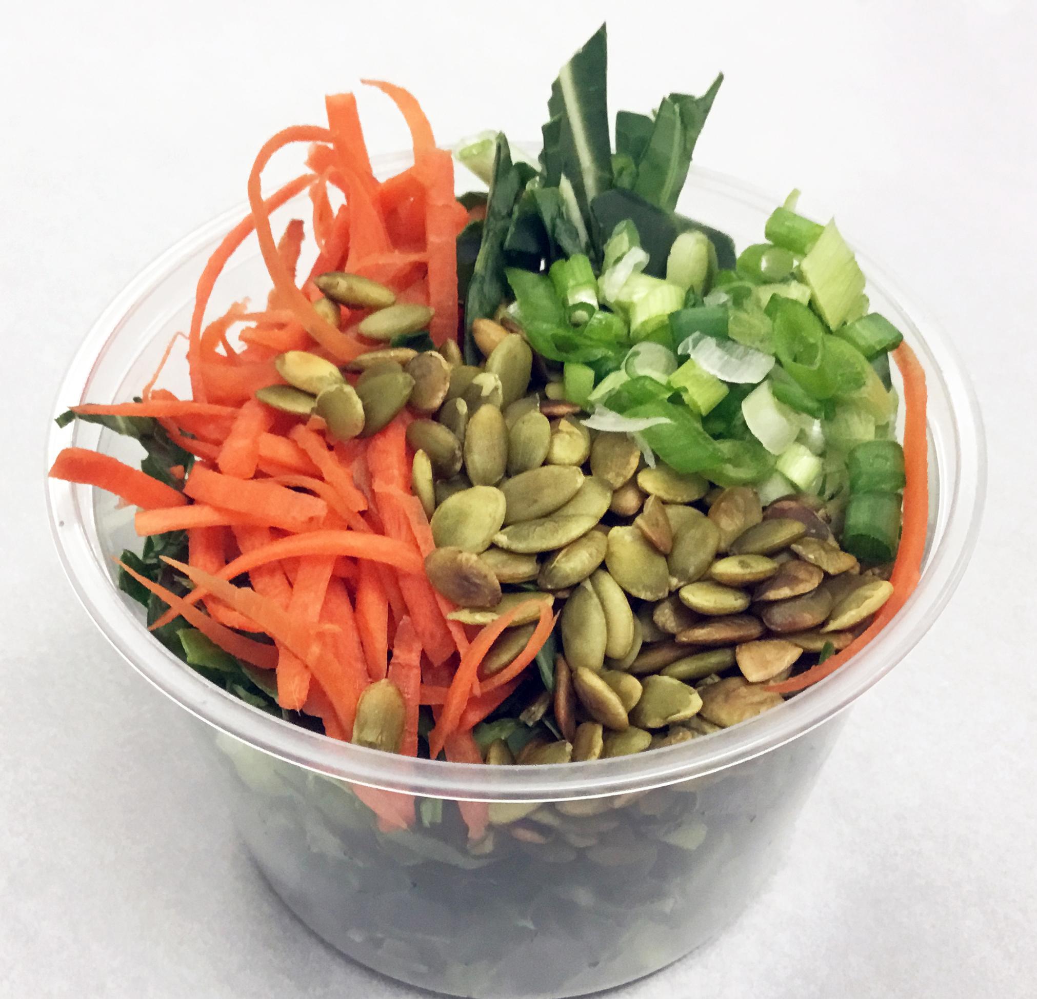 Collard green, carrot, scallions and roasted pumpkin seeds.