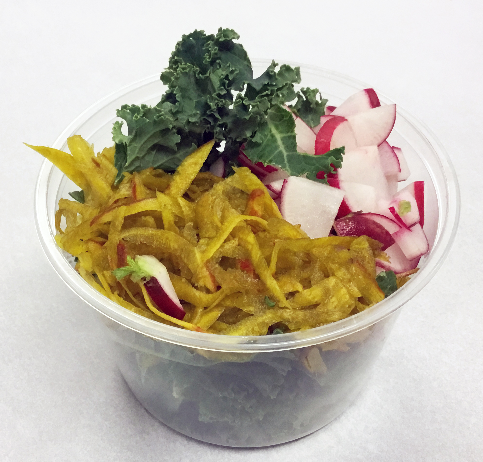 Curly kale, red radish and yellow beets.
