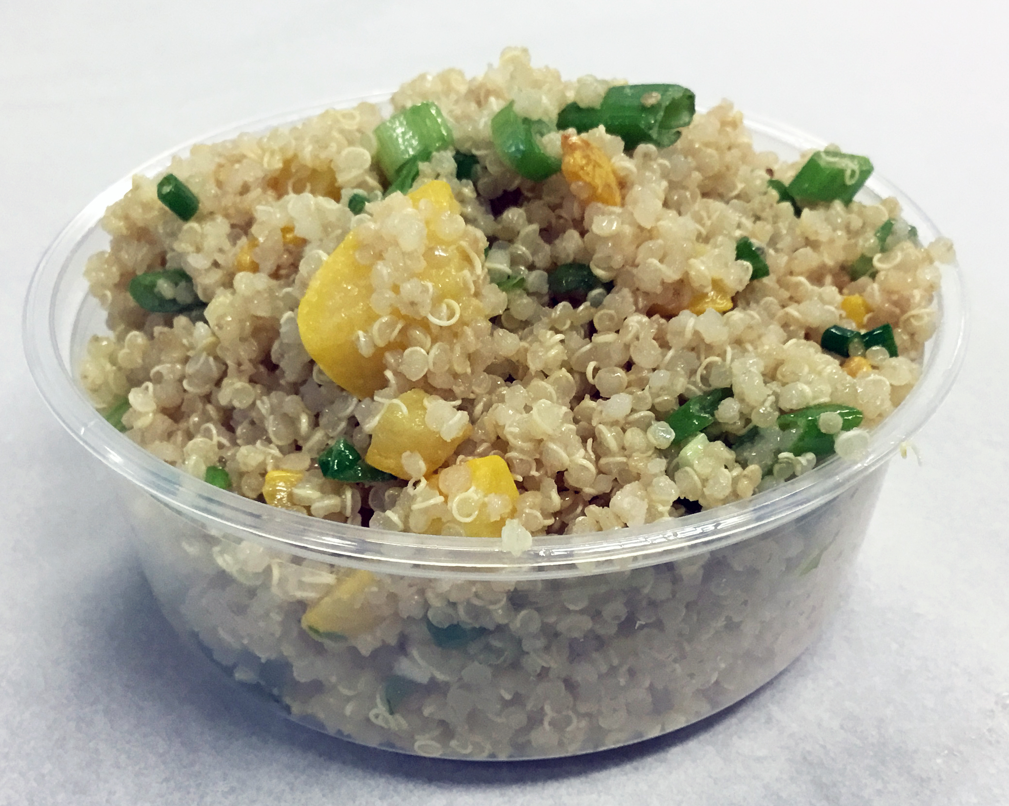 Quinoa with sauteed yellow squash, scallions and a mustard dressing.