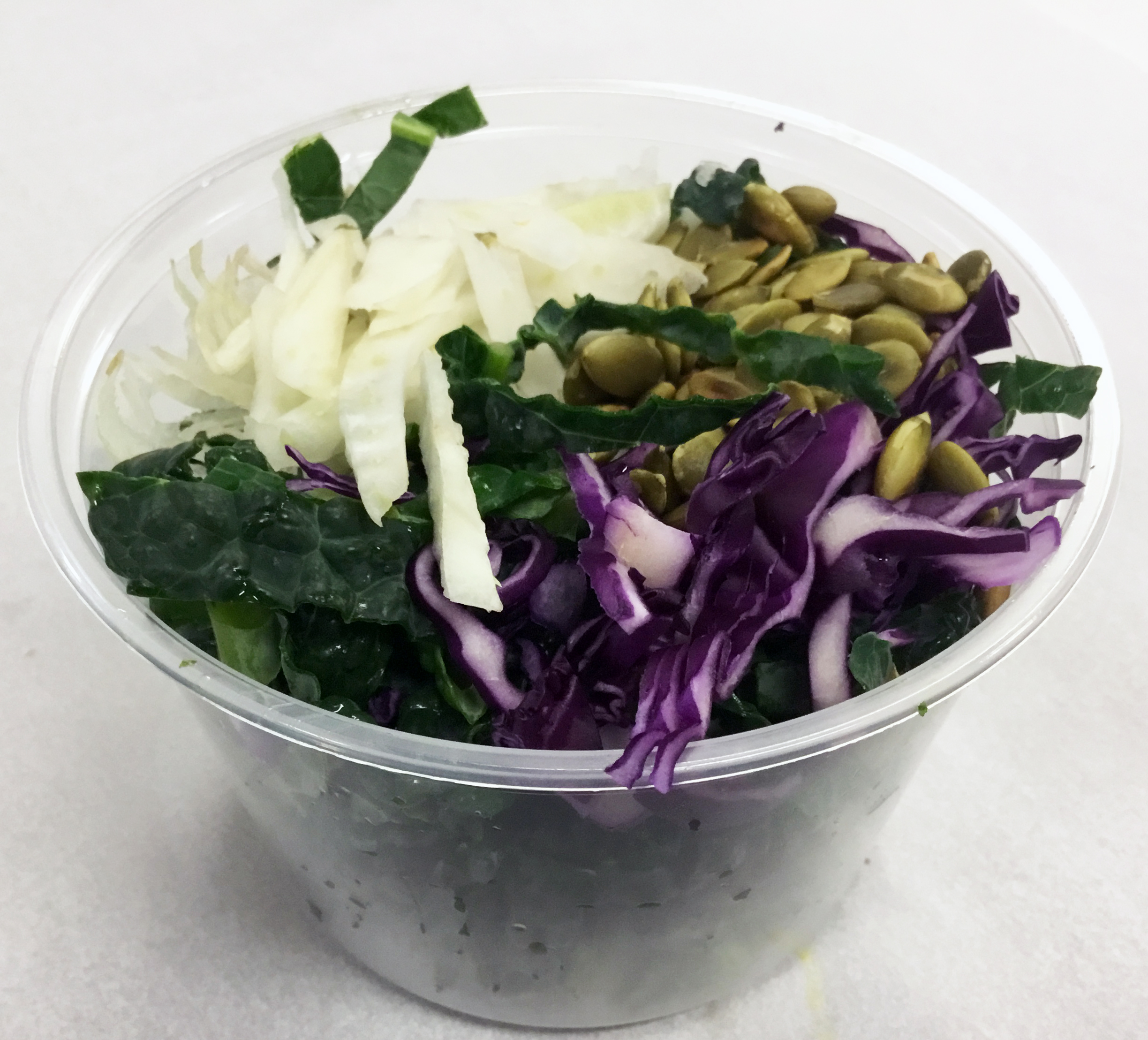 Lacinato kale with red cabbage, fennel and roasted pumpkin seeds.