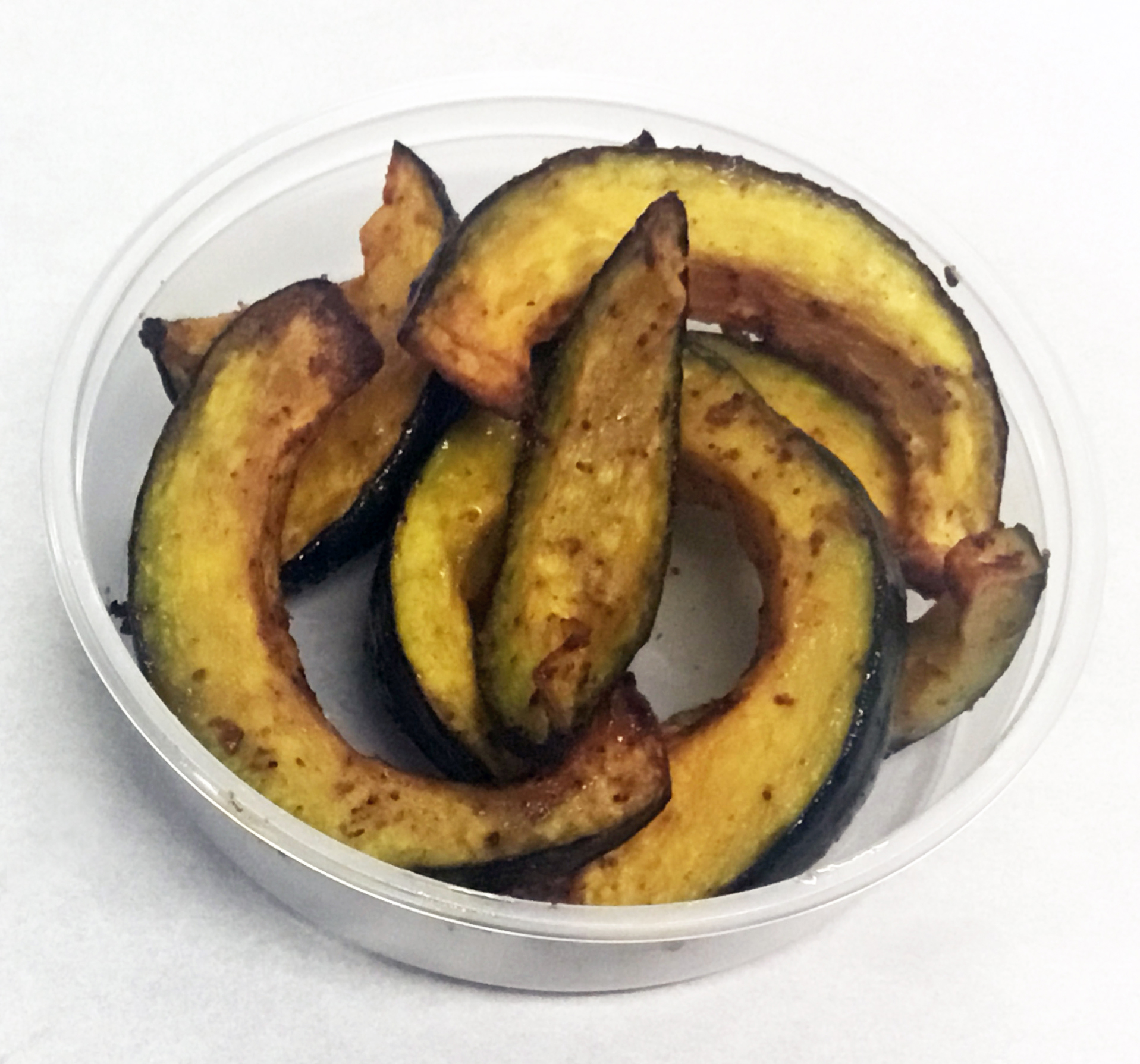 Baked kabocha squash with garlic and chili spices.