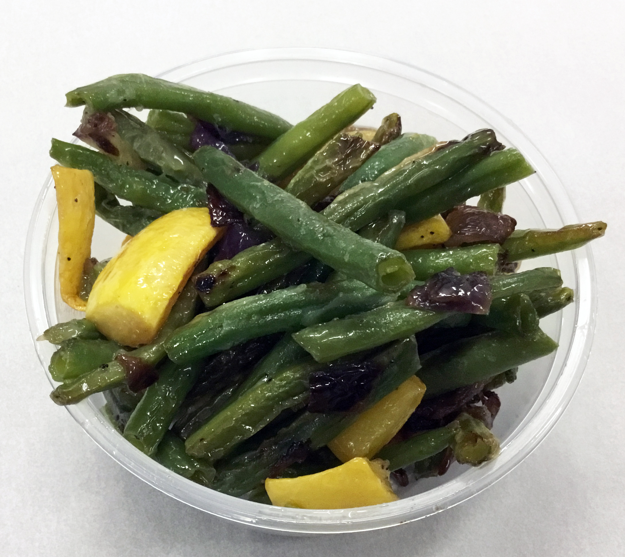 Green beans with red onion and yellow squash.
