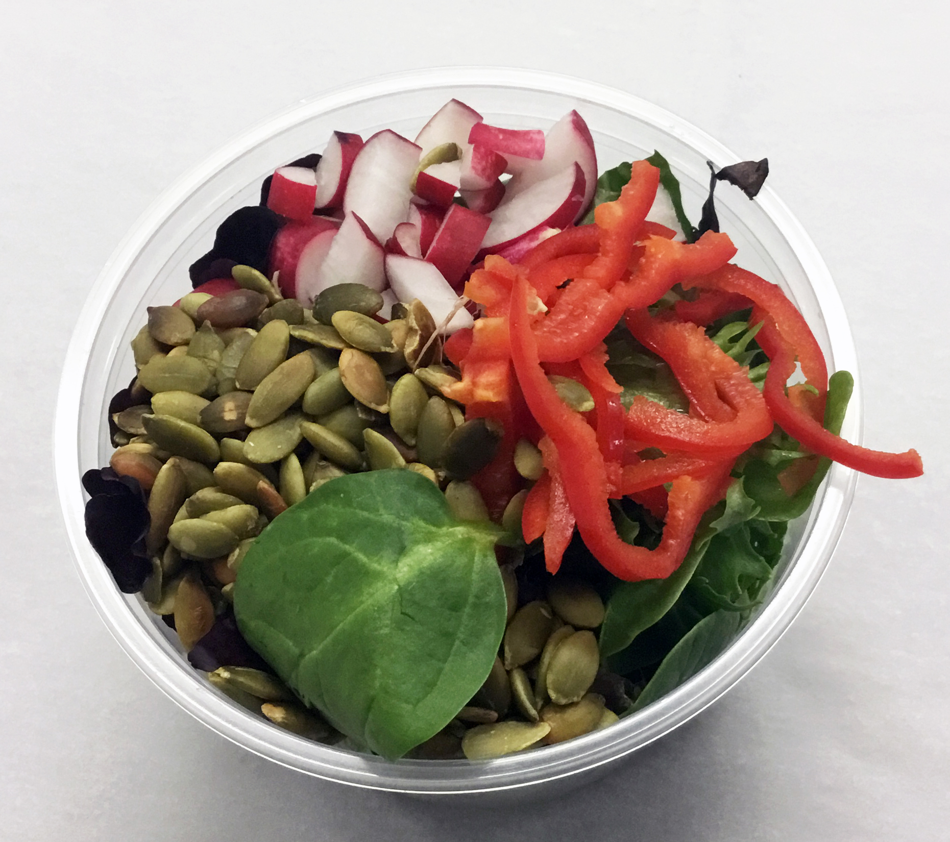 Mixed spring greens with bell peppers, red radish and roasted pumpkin seeds.