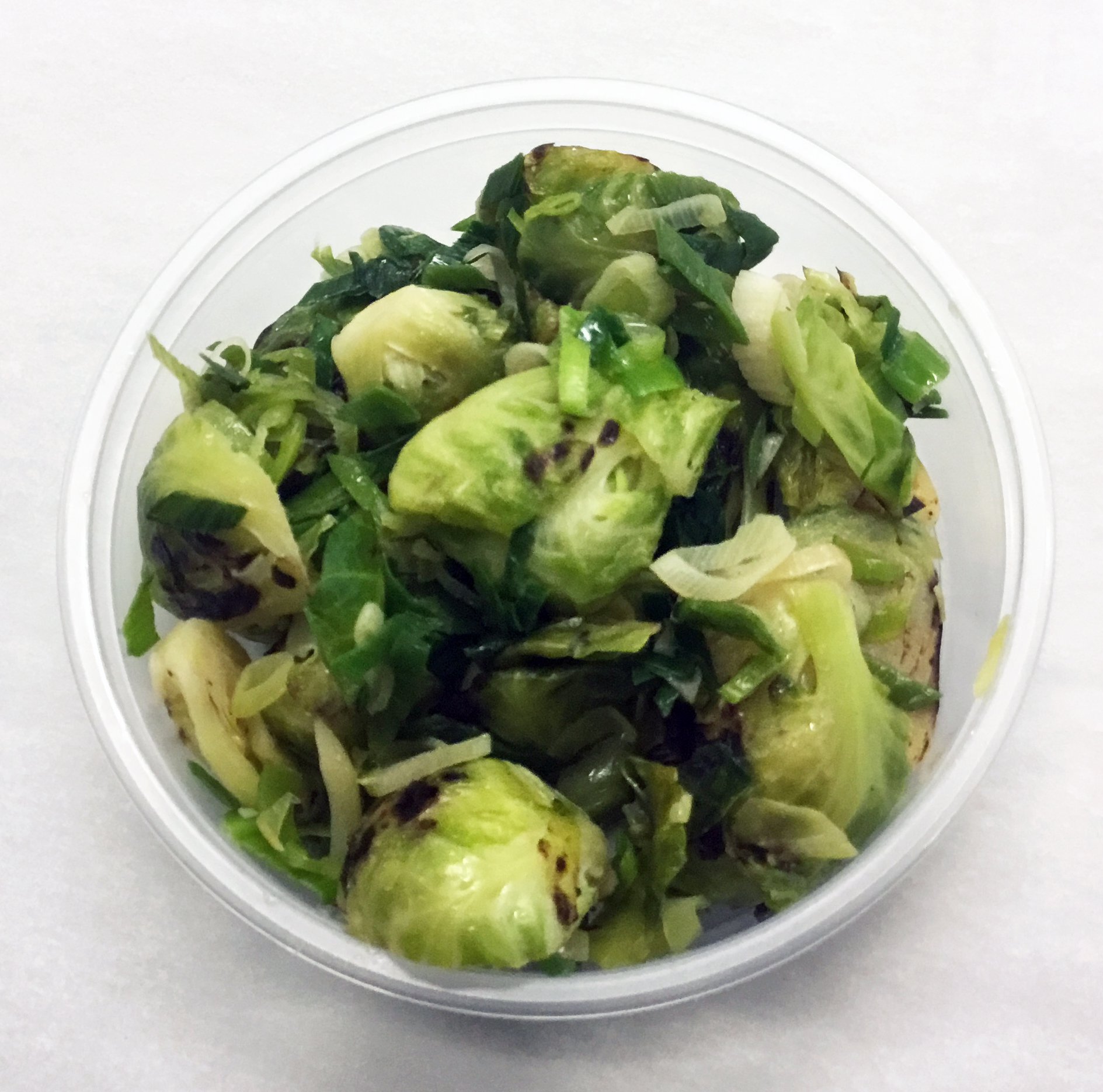 Roasted Brussel sprouts with spring onions and a tamari and brown rice syrup sauce.