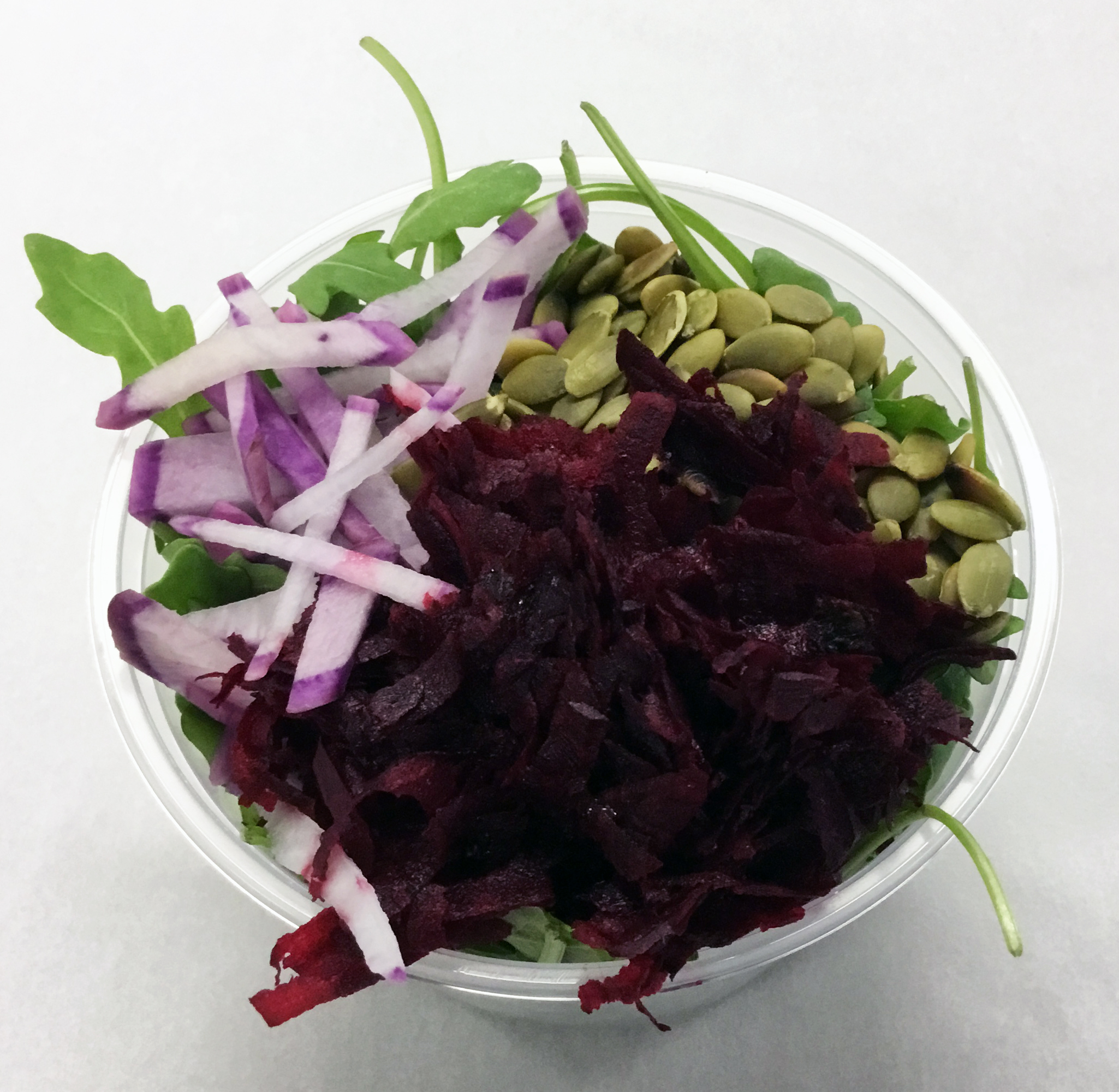 Baby arugula with red beets, purple radish and roasted pumpkin seeds.