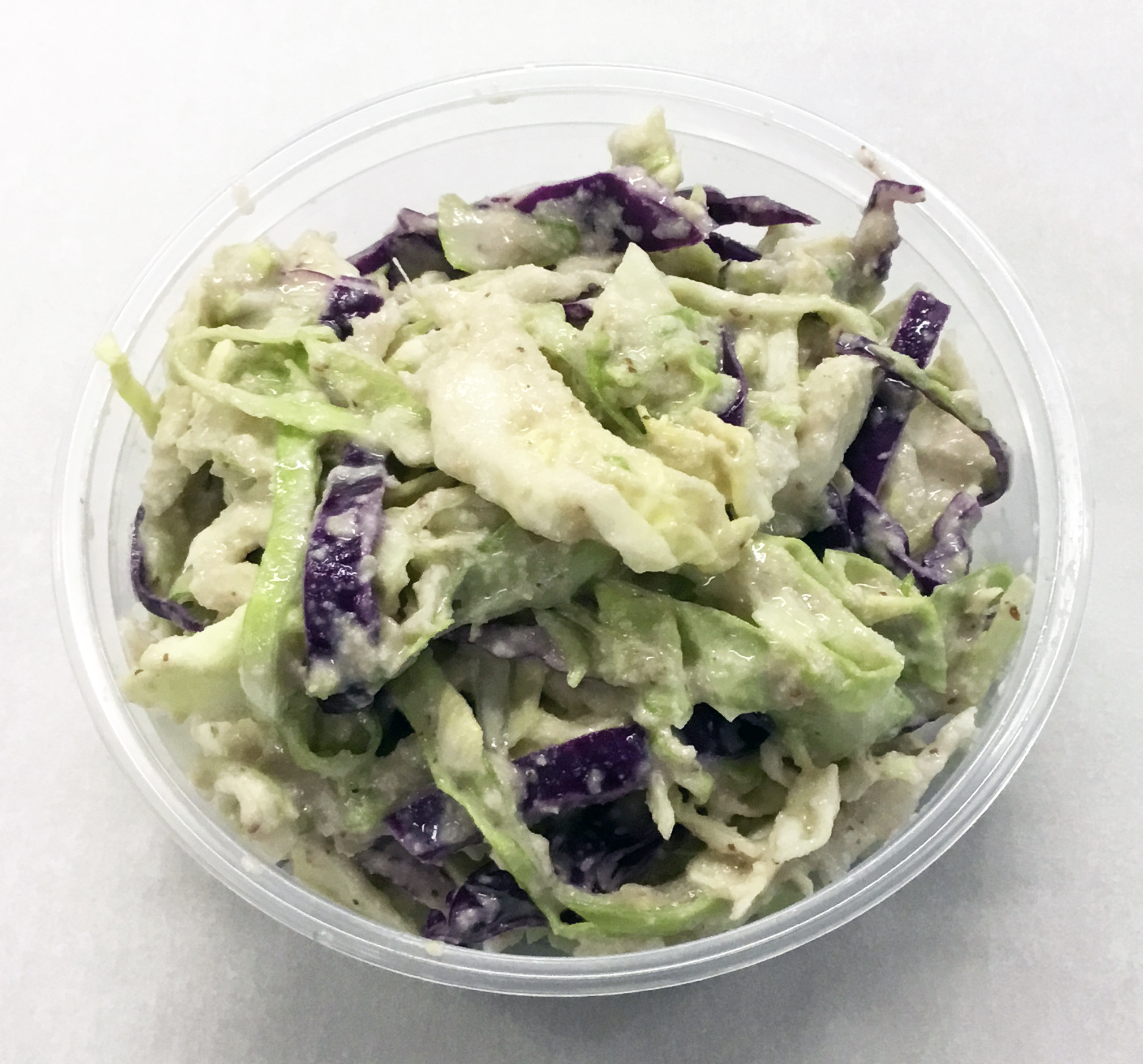 Coleslaw of green and red cabbage with a sunflower seed, stone ground mustard, brown rice vinegar and brown rice syrup dressing.