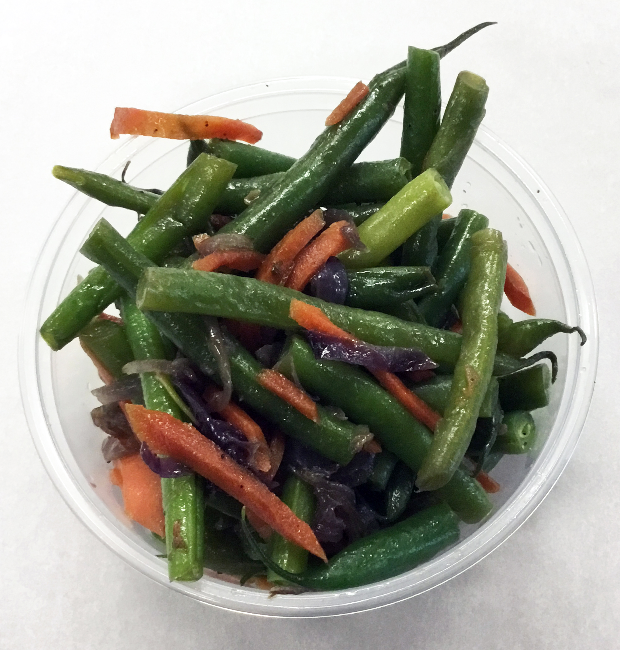 Green beans sauteed with carrot and red onion.