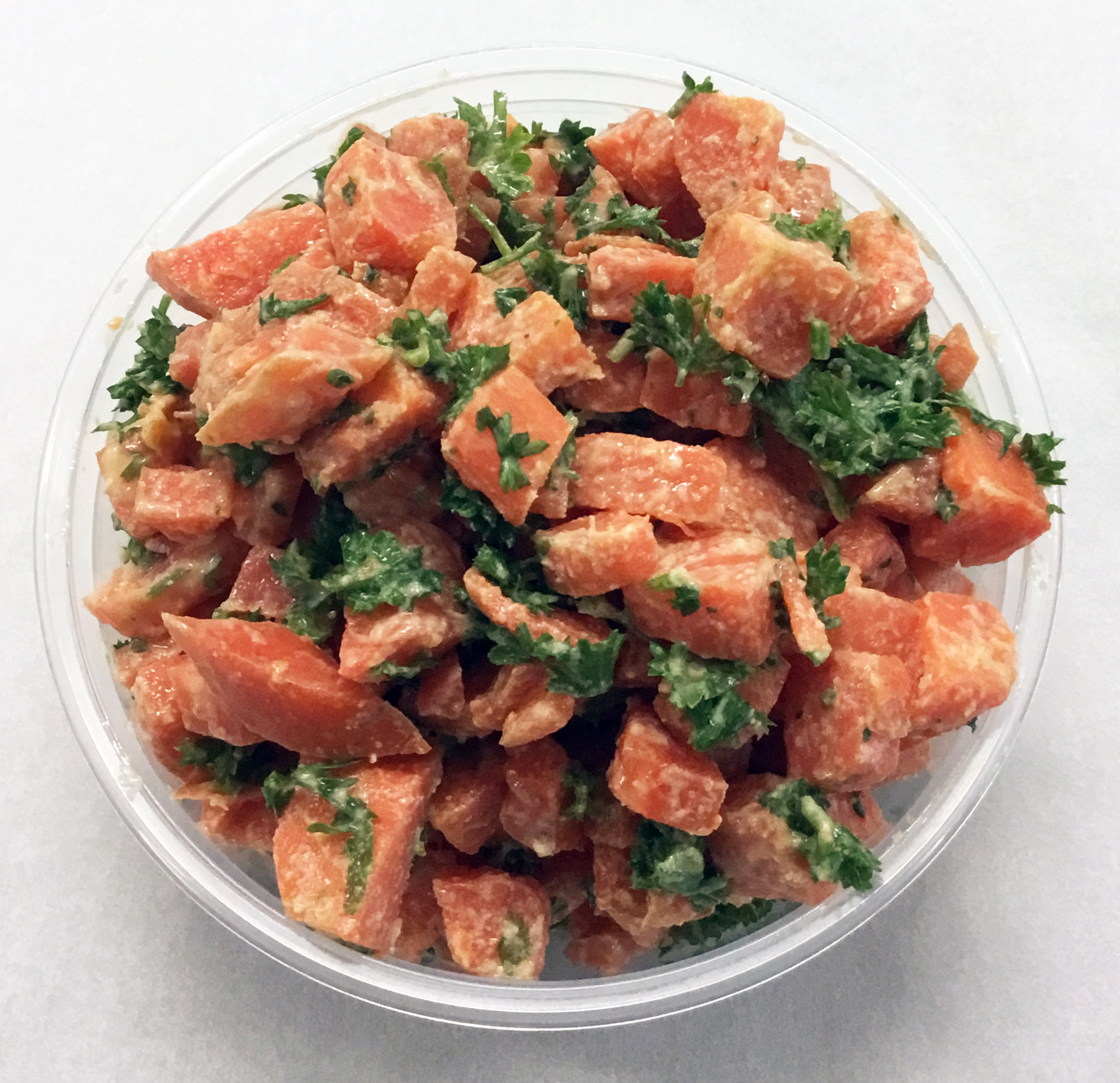 Boiled salad of carrots with parsley and a tahini and fresh squeezed lemon dressing.