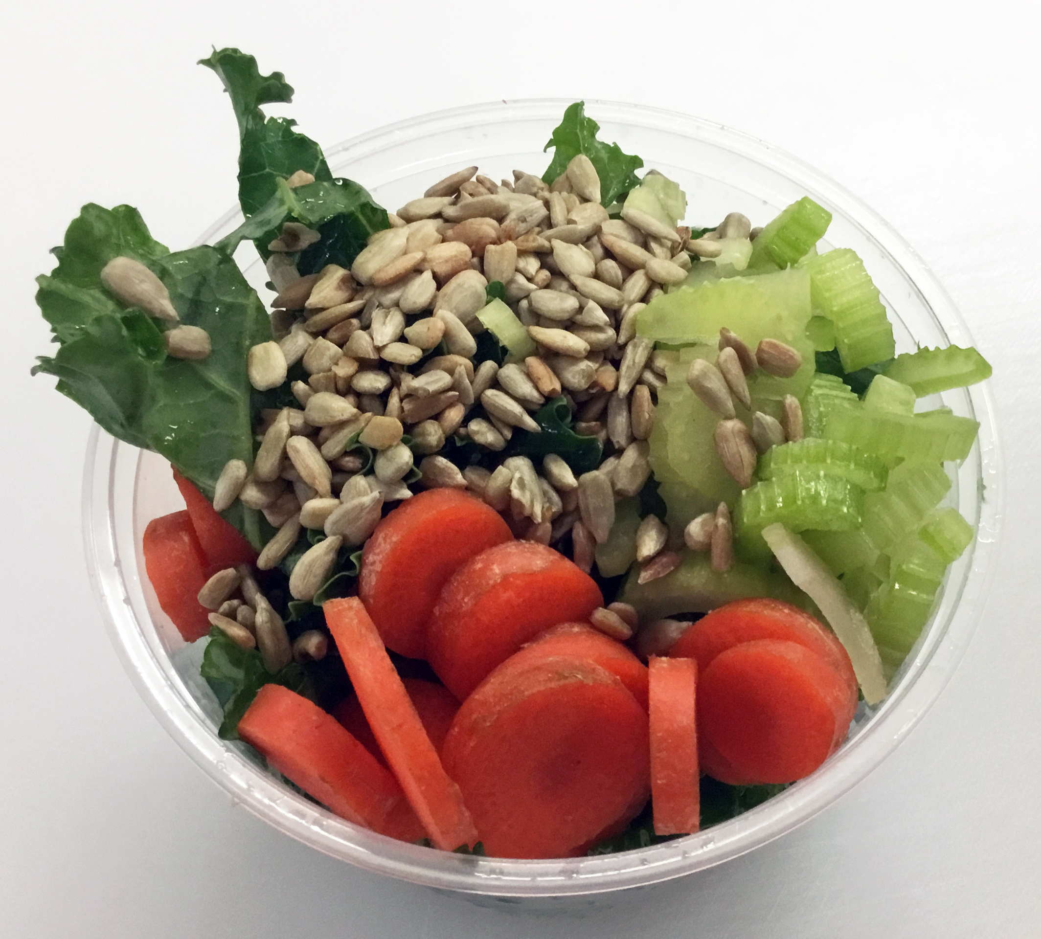 Kale with carrots, celery and toasted sunflower seeds.