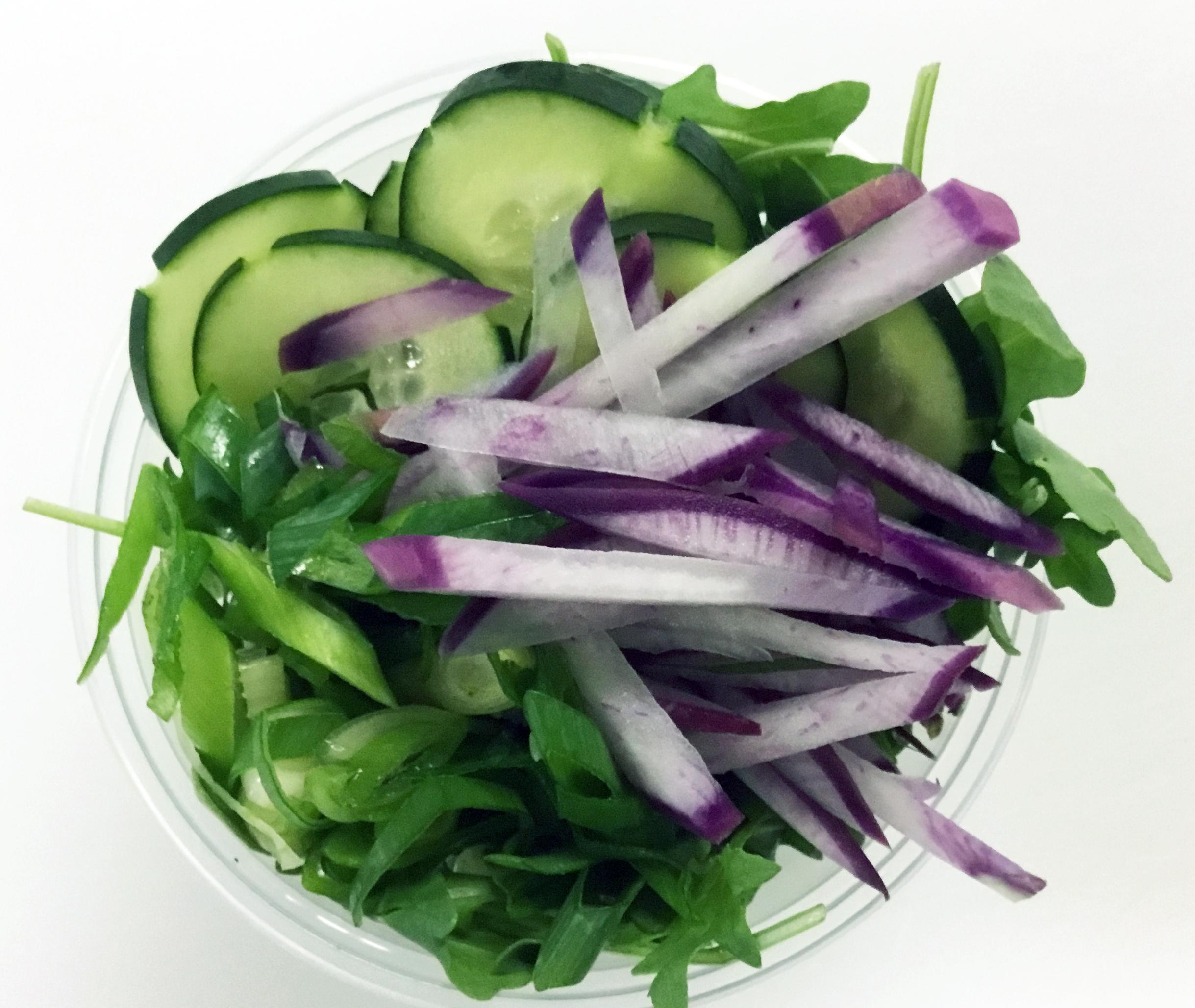 Arugula with purple radish, cucumber and scallions.