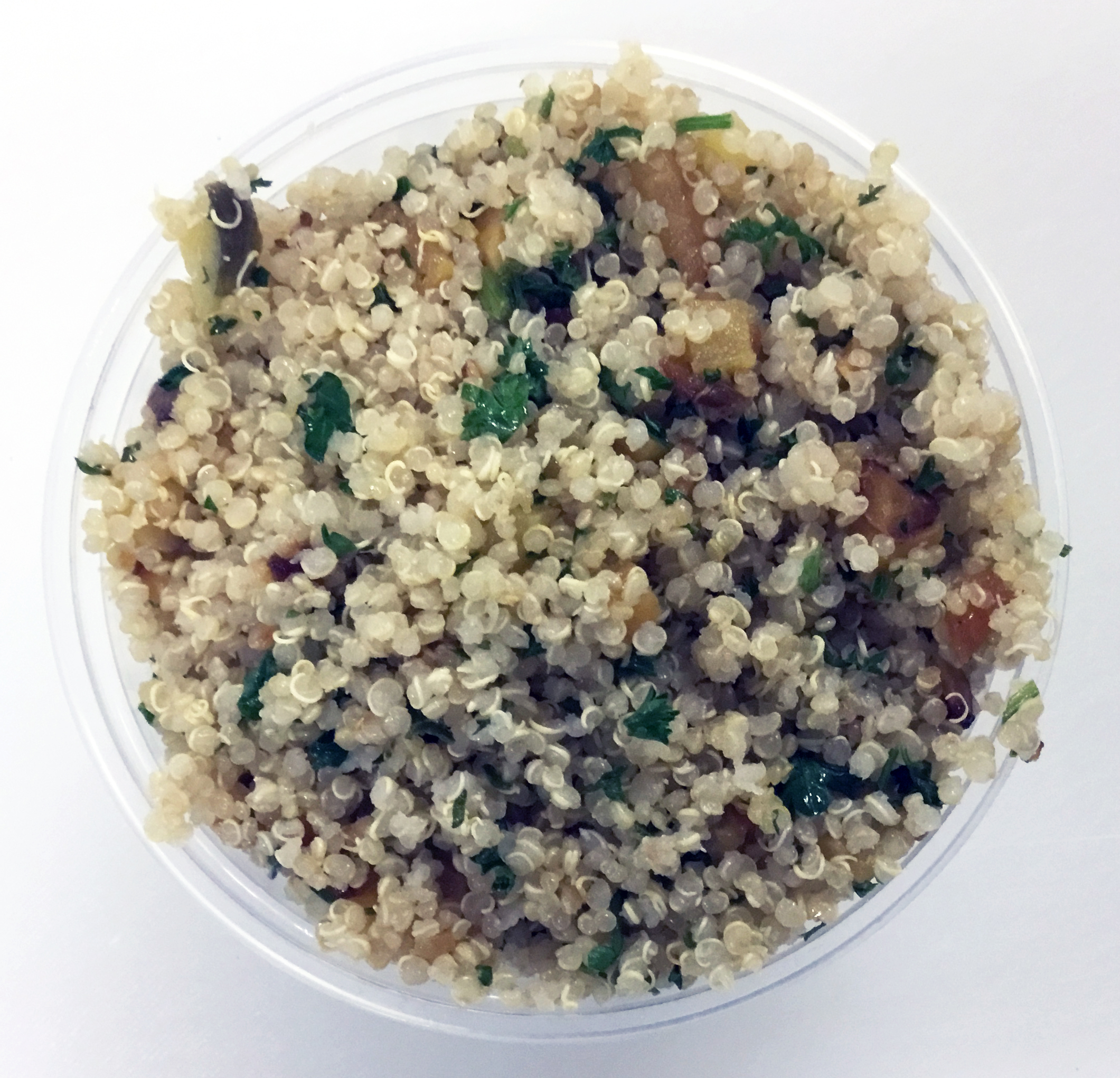 Quinoa with sautéed rutabaga, parsley and a brown rice vinegar dressing.