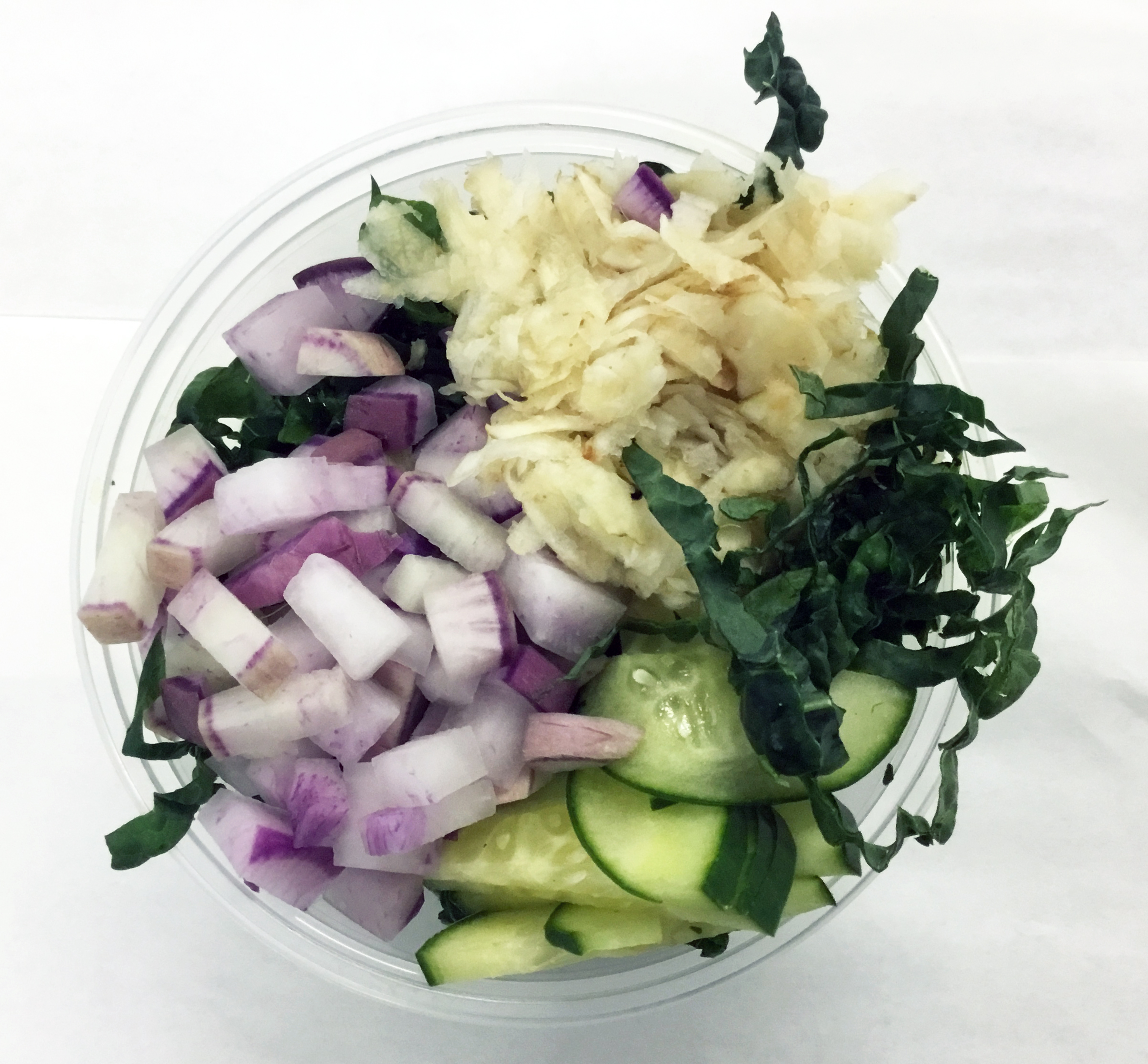 Lacinato kale salad with purple radish, celery root and cucumber.