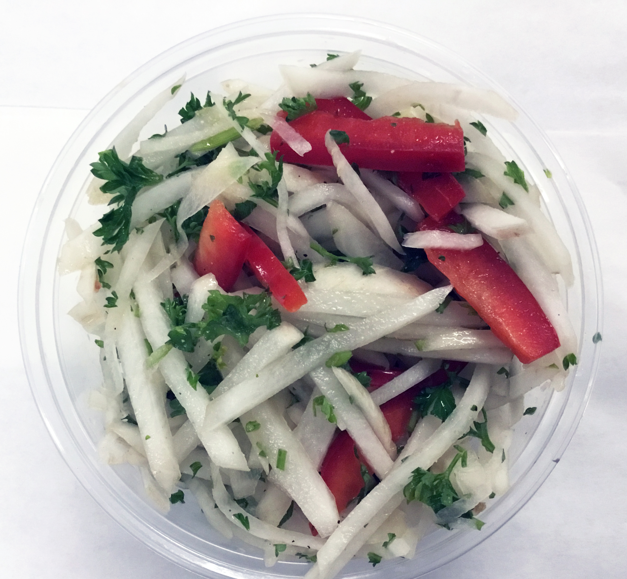 Daikon radish and red bell peppers with parsley.