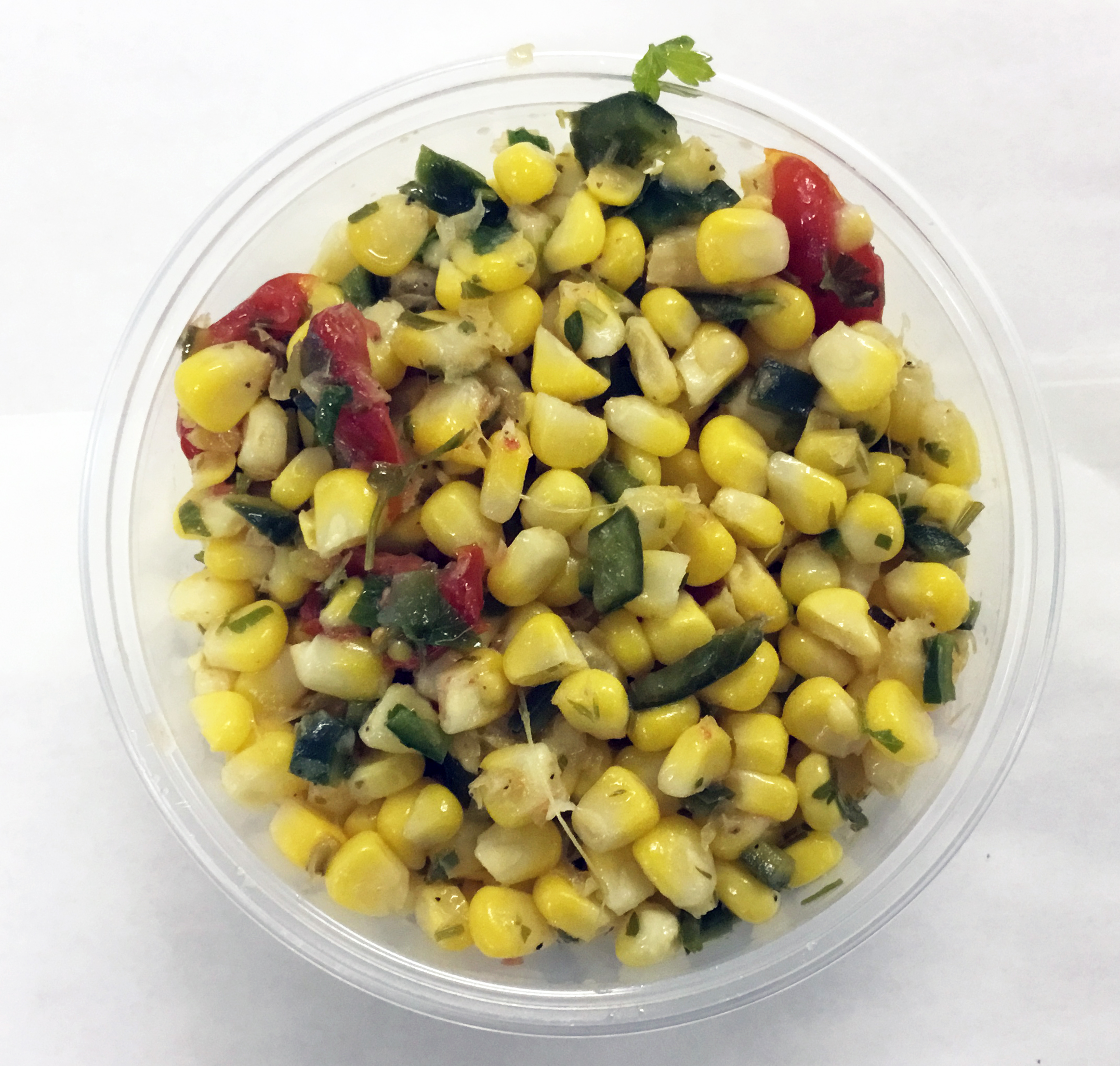 Corn salad with Poblano peppers, cherry tomatoes, parsley and an apple cider vinegar dressing.