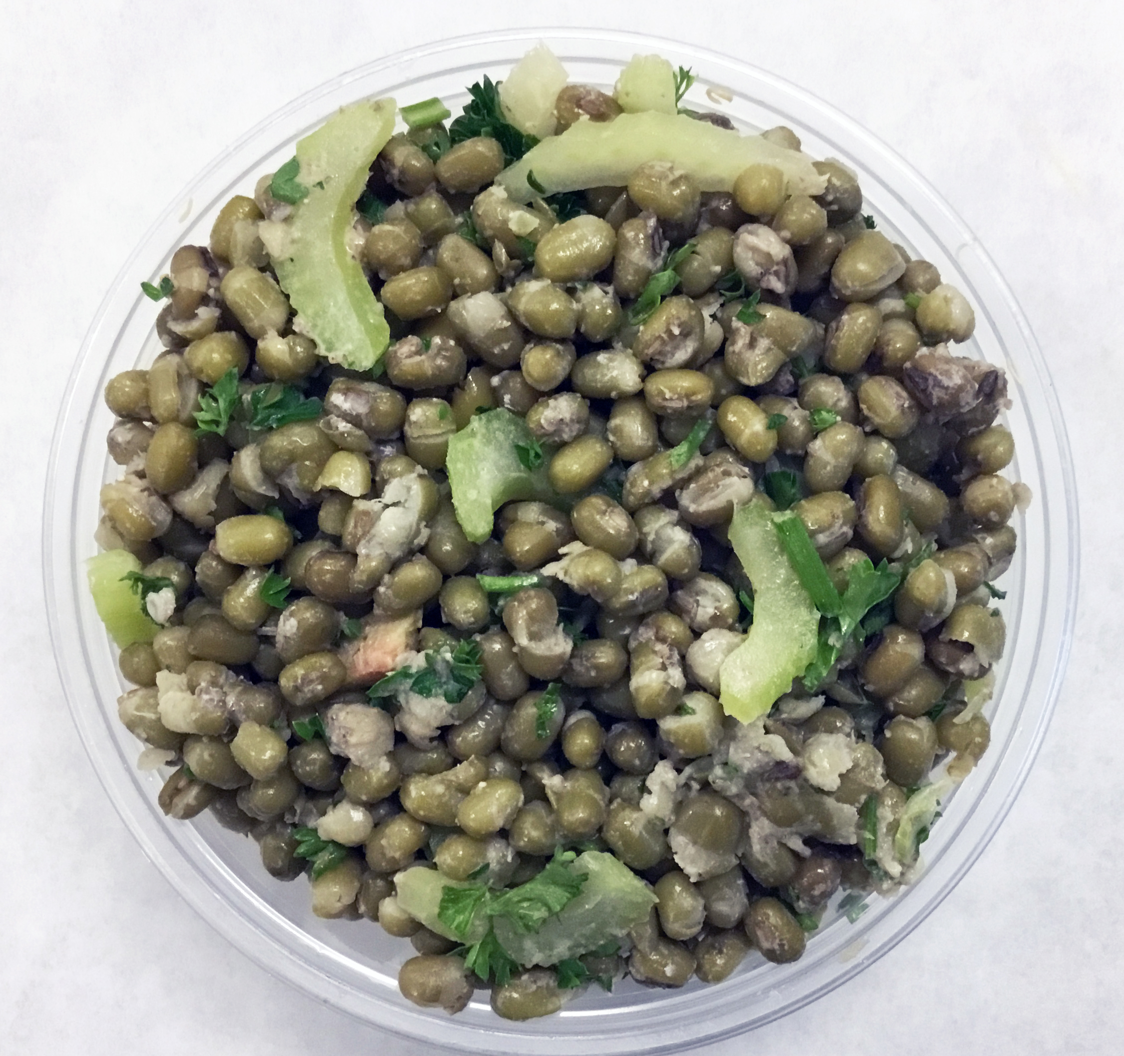 Mung beans, celery, parsnip, olives, garlic, dates, yuzu and chia dressing.