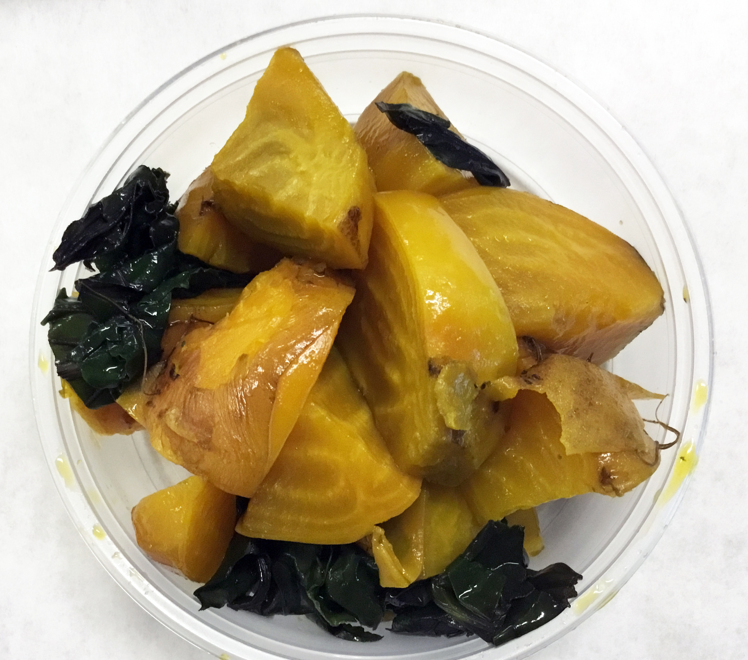 Steamed yellow beets with tops.
